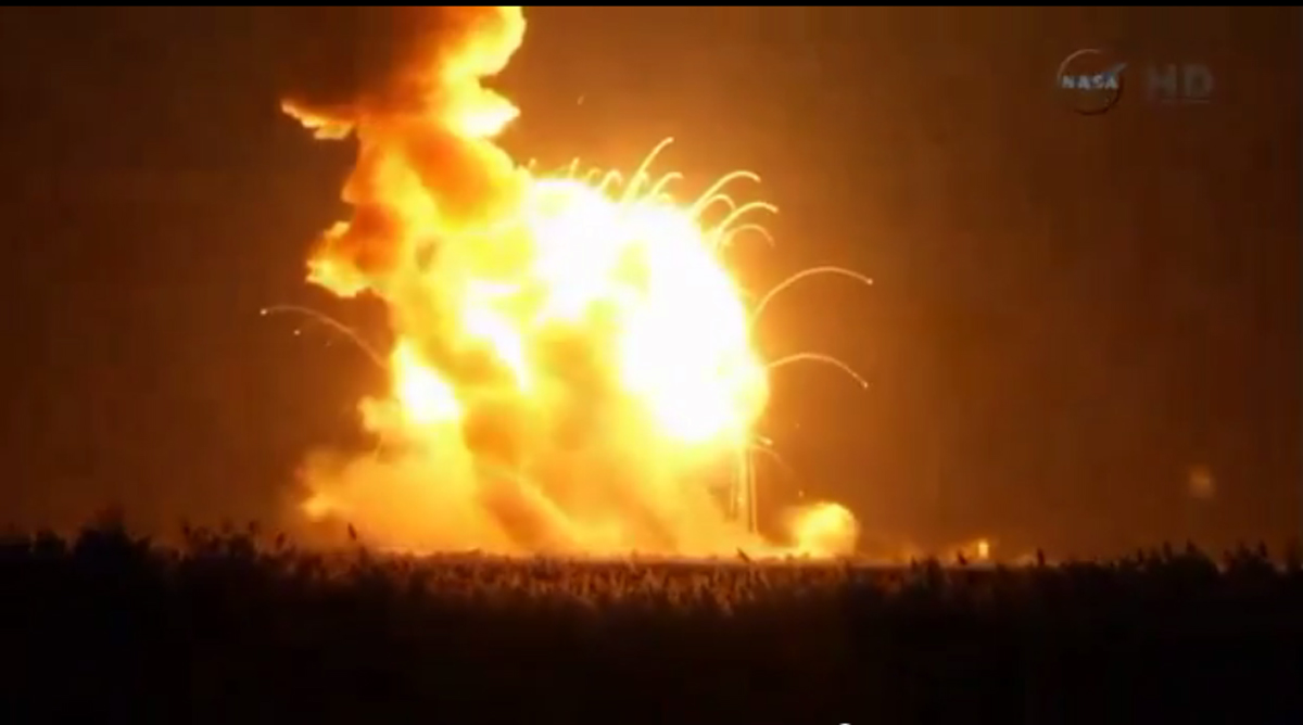 An unmanned Antares rocket is seen exploding seconds after lift off from a commercial launch pad