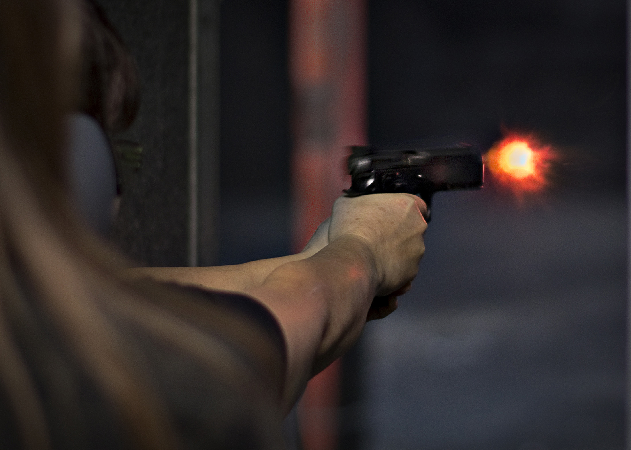 A visitor of DVC Indoor Shooting Centre fires a pistol on their range in Port Coquitlam, British Columbia