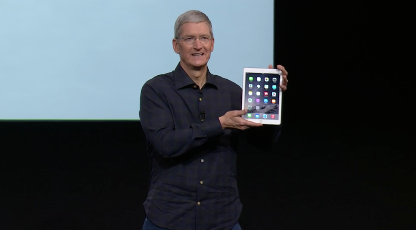 Apple CEO Tim Cook holds up new iPad Air 2.