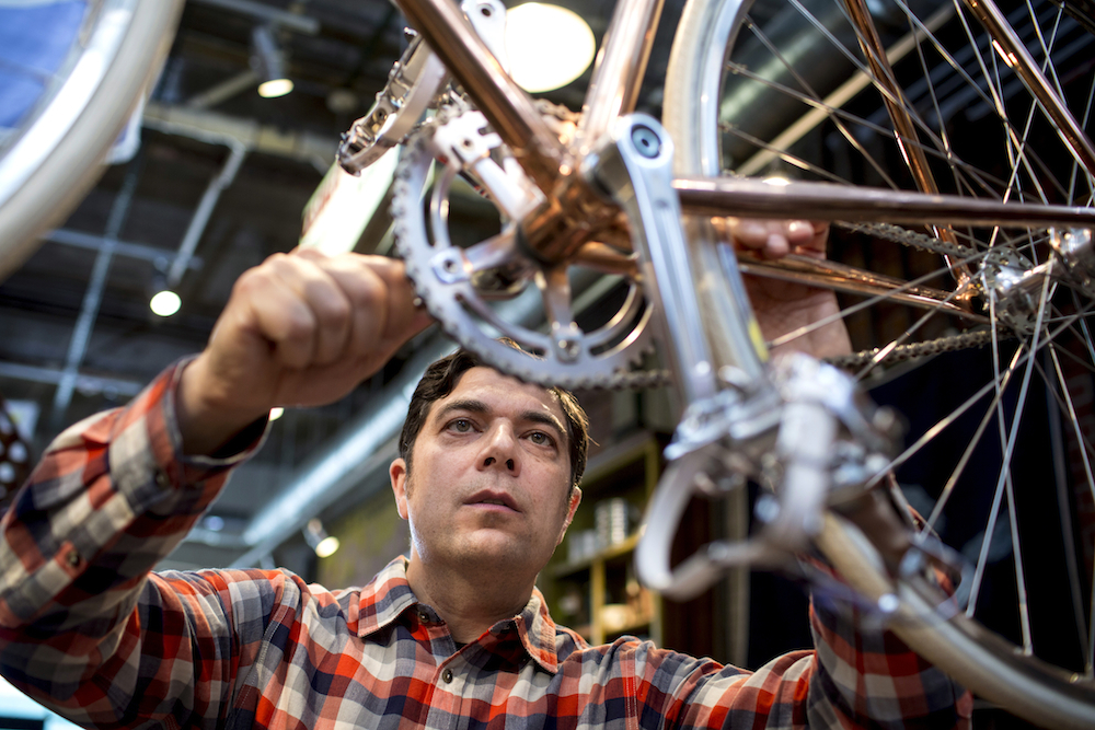 Steven Bock, owner of Detroit Bicycling Co. stands for a portrait with one of his handcrafted bikes, the Trumbull Street, in Detroit, on Oct. 3, 2014.