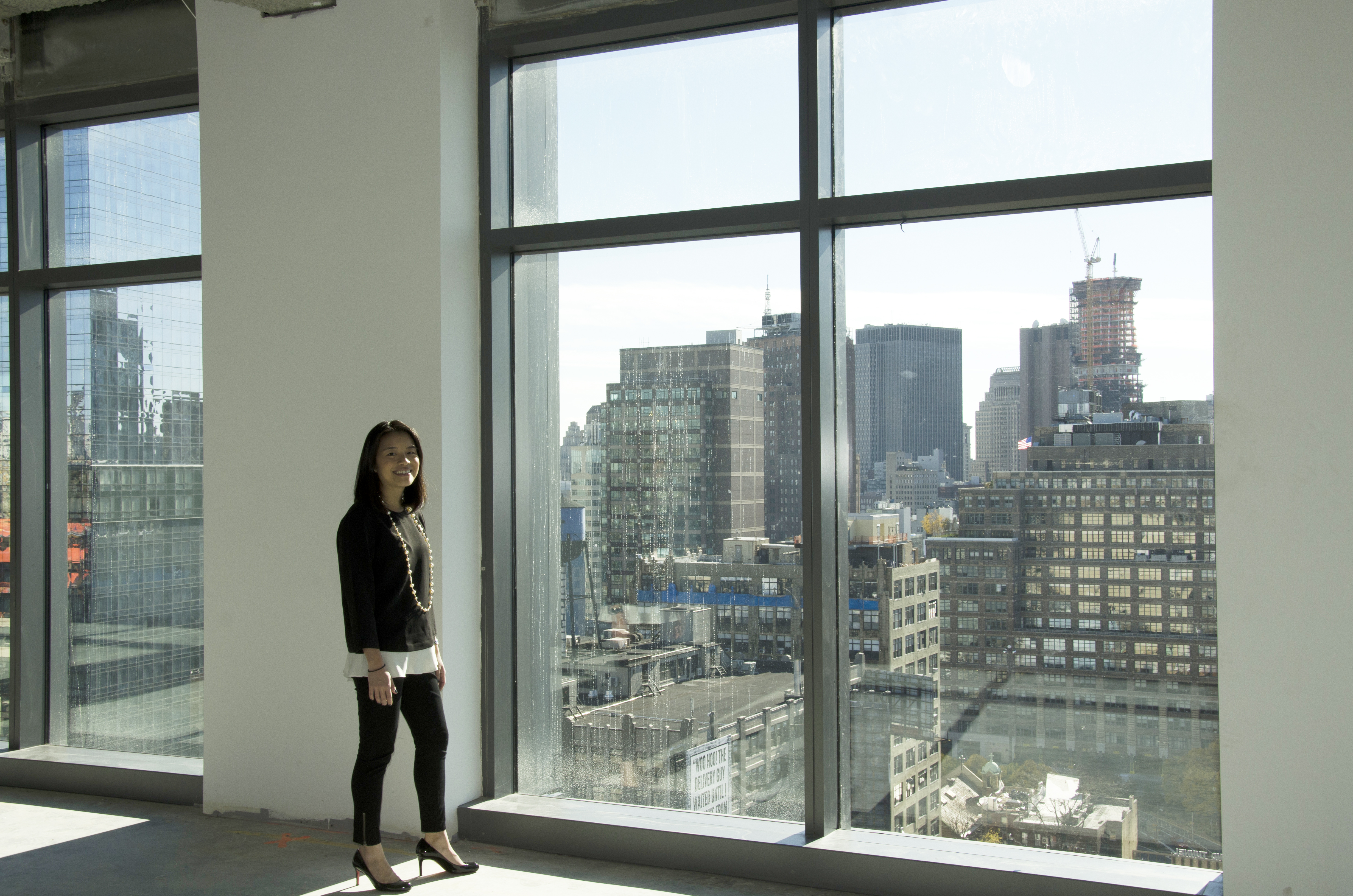Melody Lee, director of brand and reputation strategy for Cadillac, stands in Cadillac's newly purchased offices in downtown New York City.