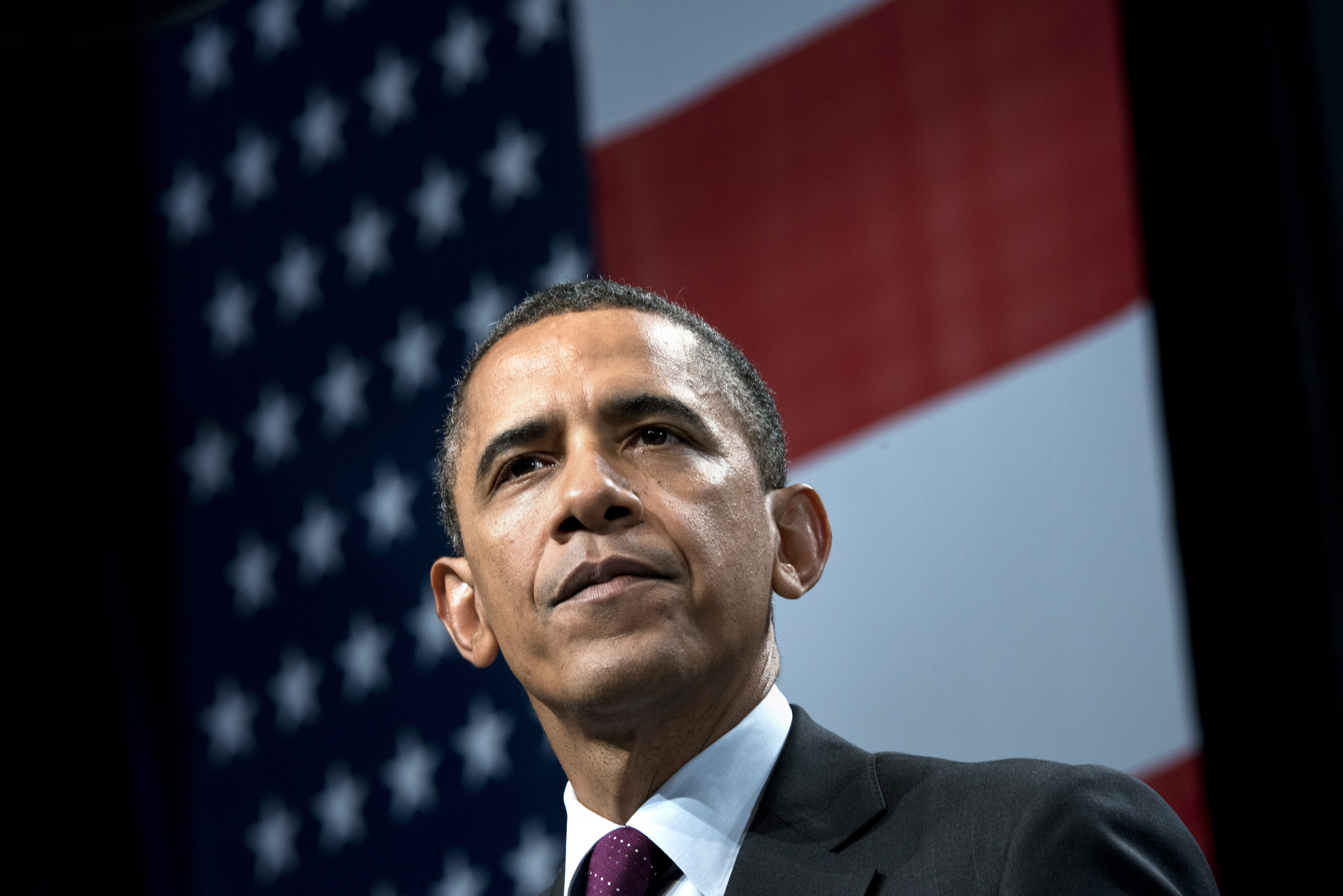 US President Barack Obama pauses while s