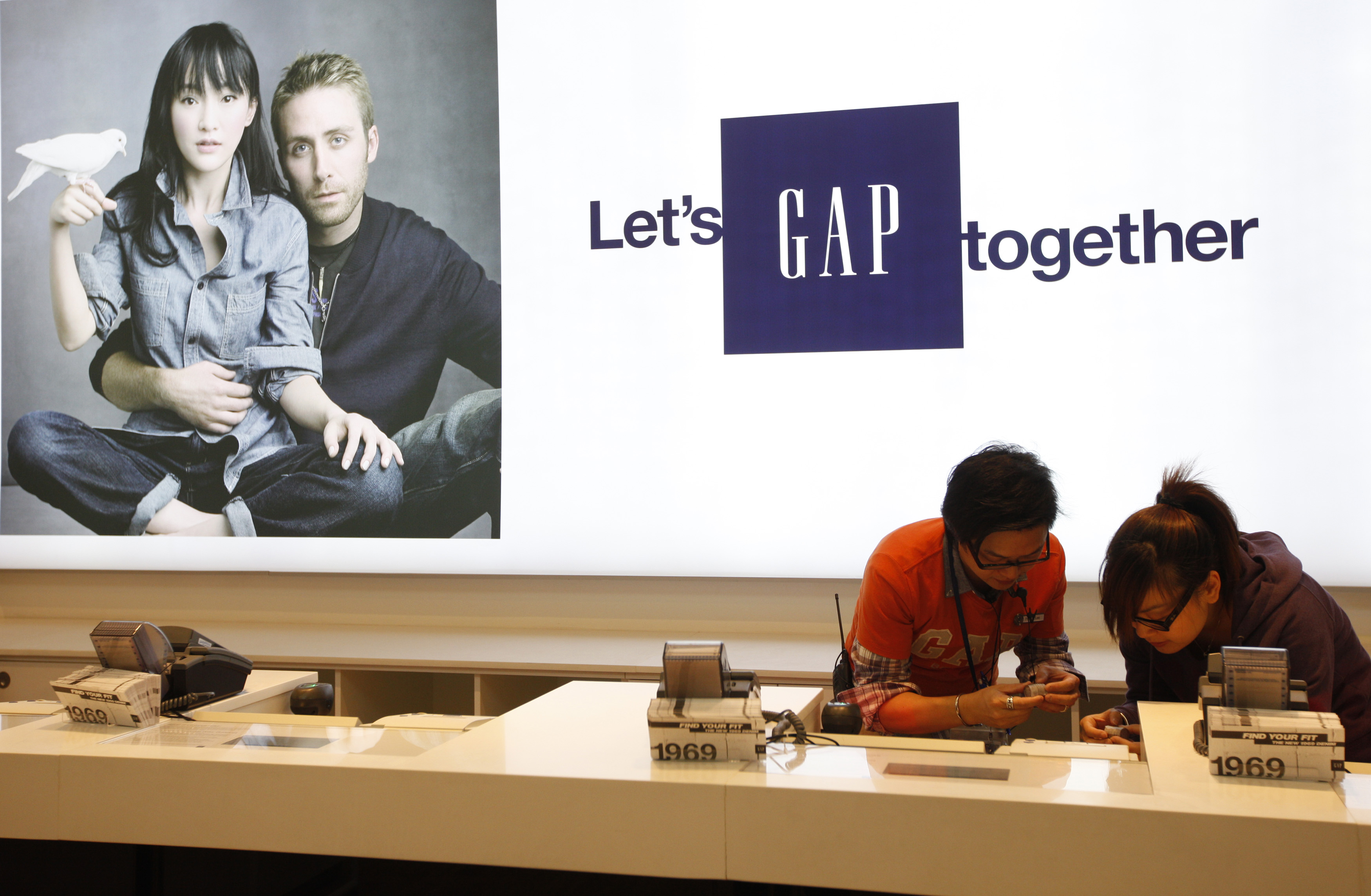 Gap sales assistants make last minute preparation at Hong Kong's first Gap Store before its opening in the financial Central district