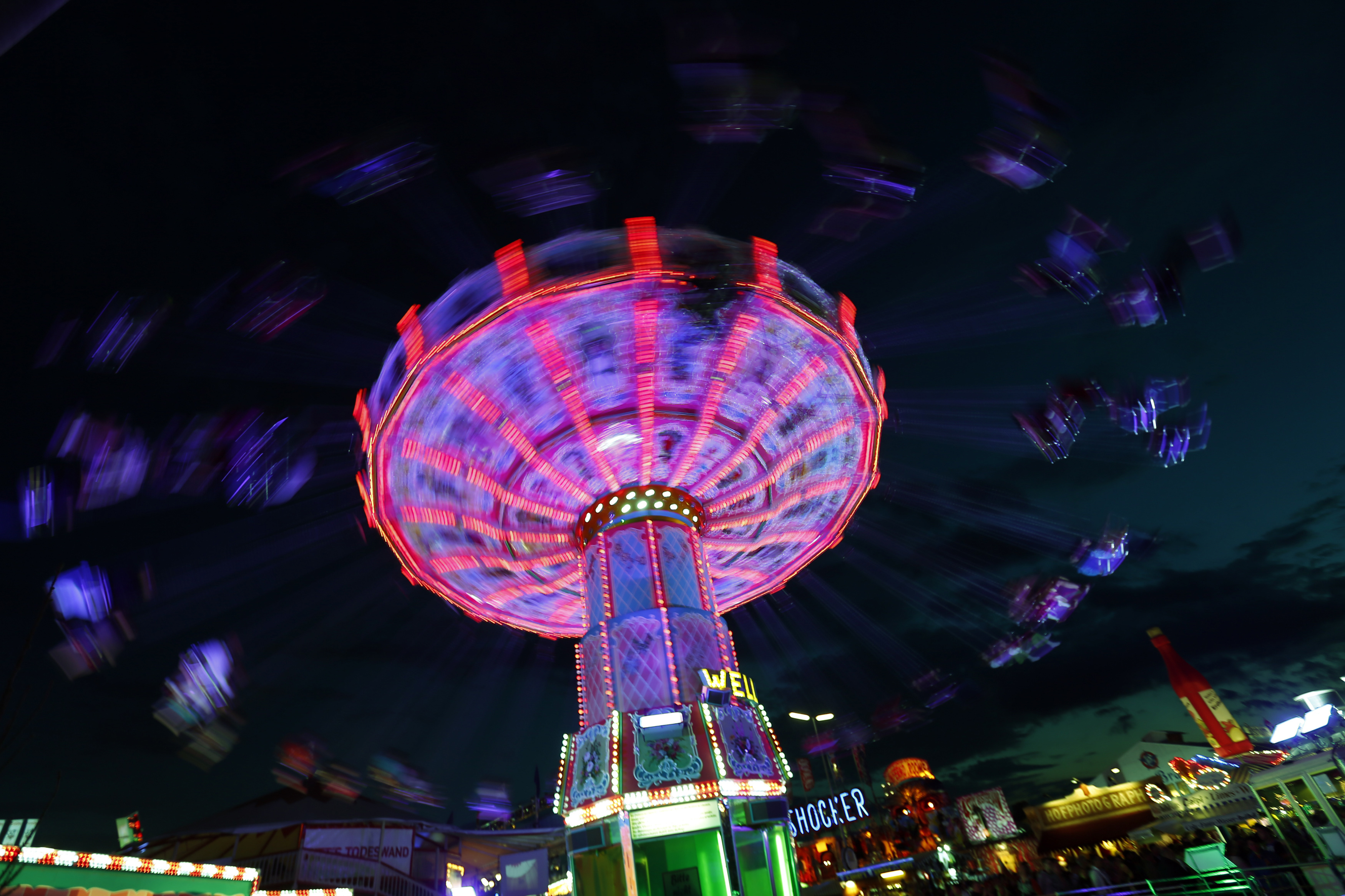 Visitors ride a merry-go-round during the opening day of the Oktoberfest in Munich