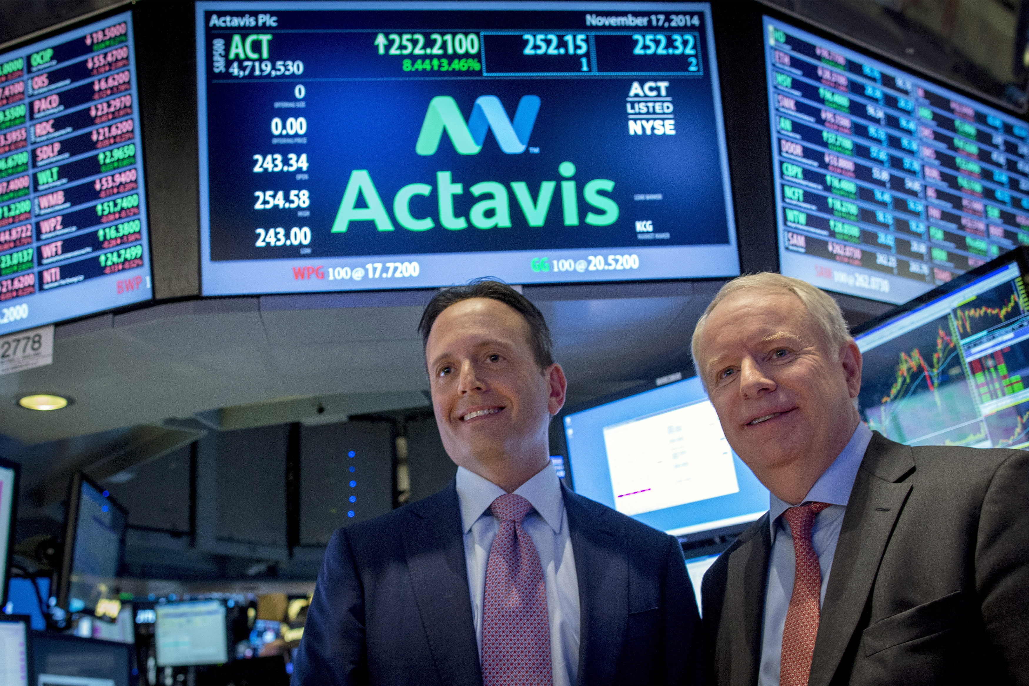 Actavis CEO Brenton Saunders and Allergan CEO David Pyotton pose together on the floor of the New York Stock Exchange