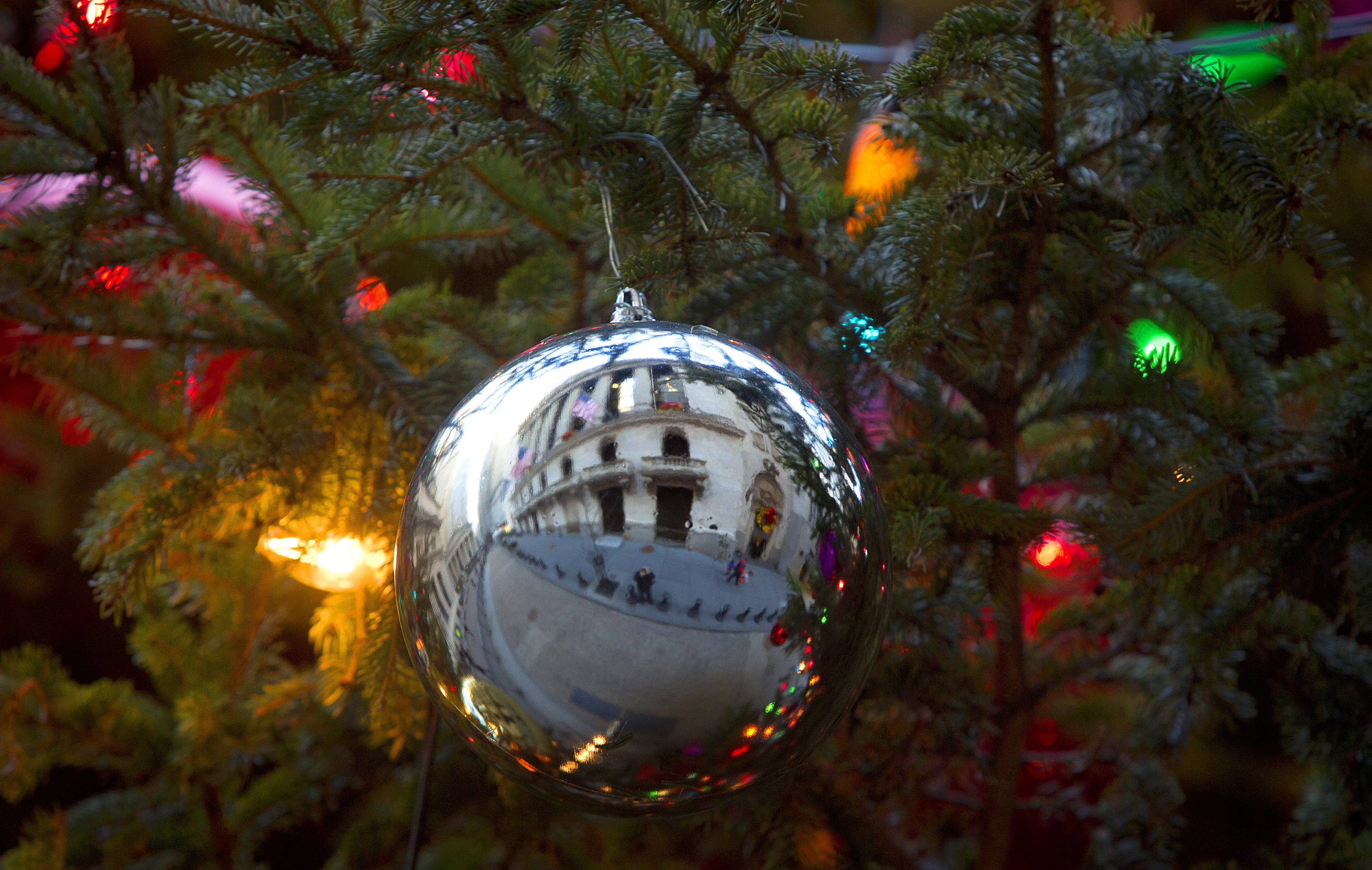 The New York Stock Exchange is pictured reflected in a Christmas Ornament in a tree in New York