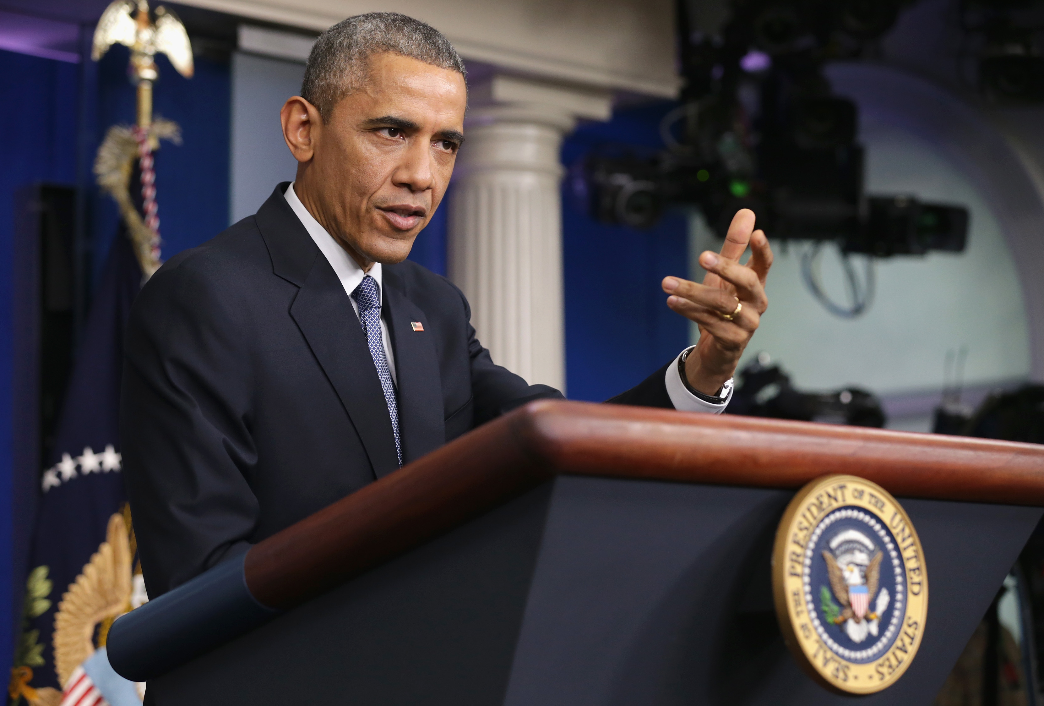 President Barack Obama speaks to members of the media during his last news conference of the year.