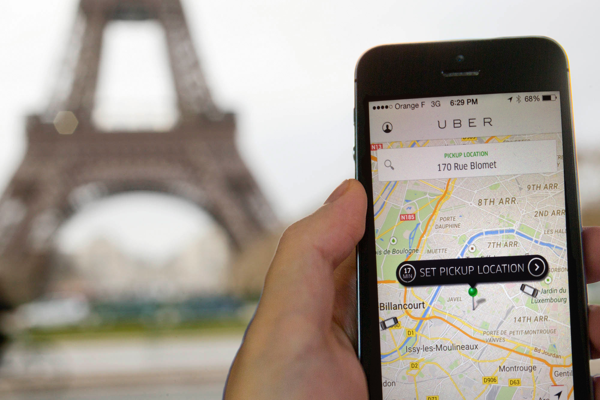The Eiffel Tower seen on the screen of a cellphone in Paris,