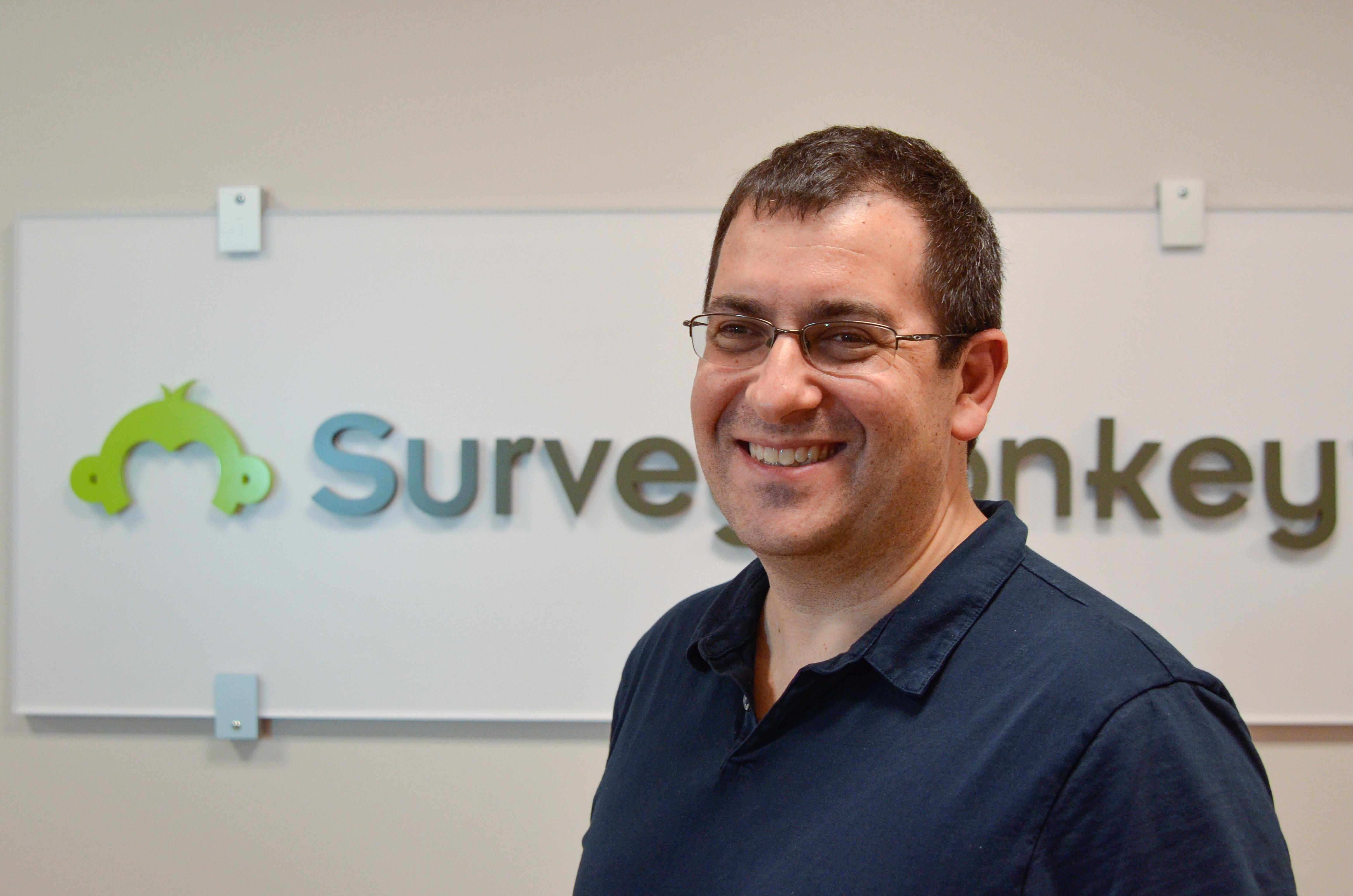 SurveyMonkey CEO David Goldberg with company logo