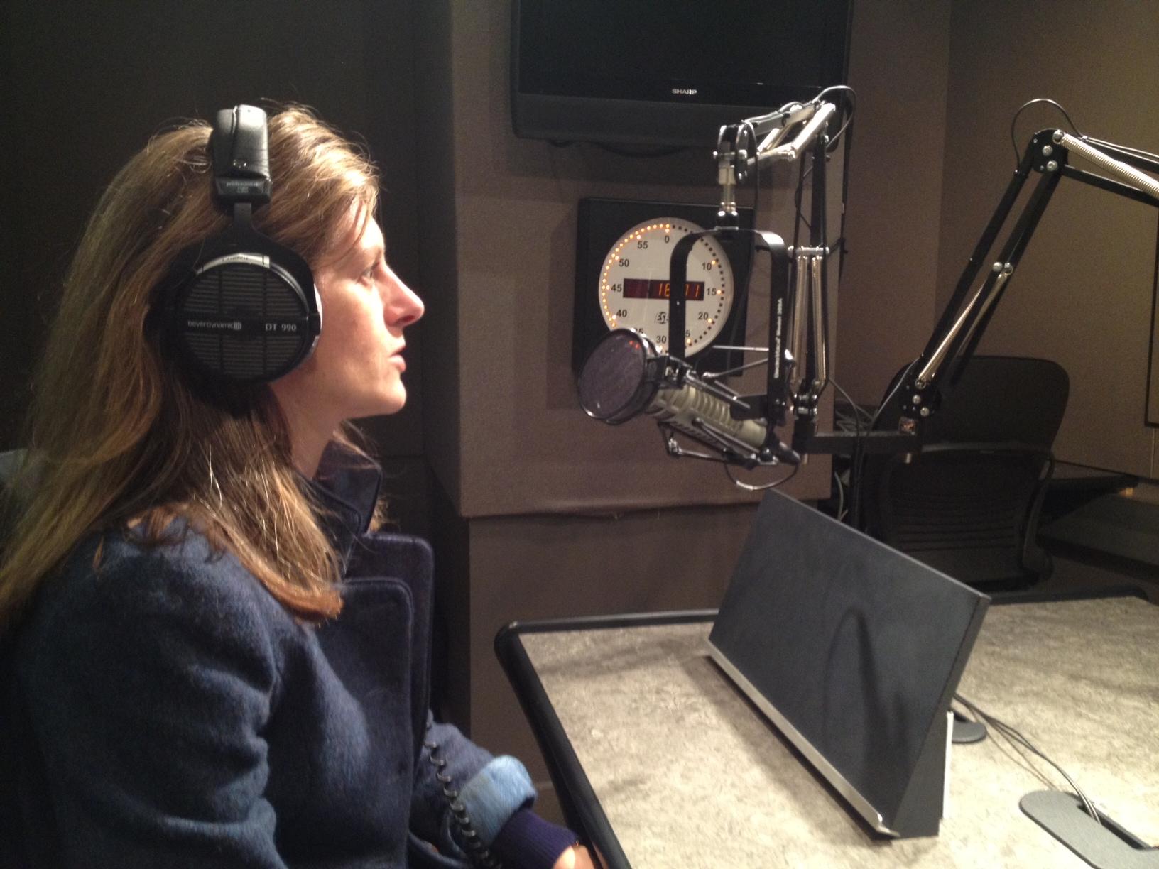 Ashley Milne-Tyte recording in a studio.