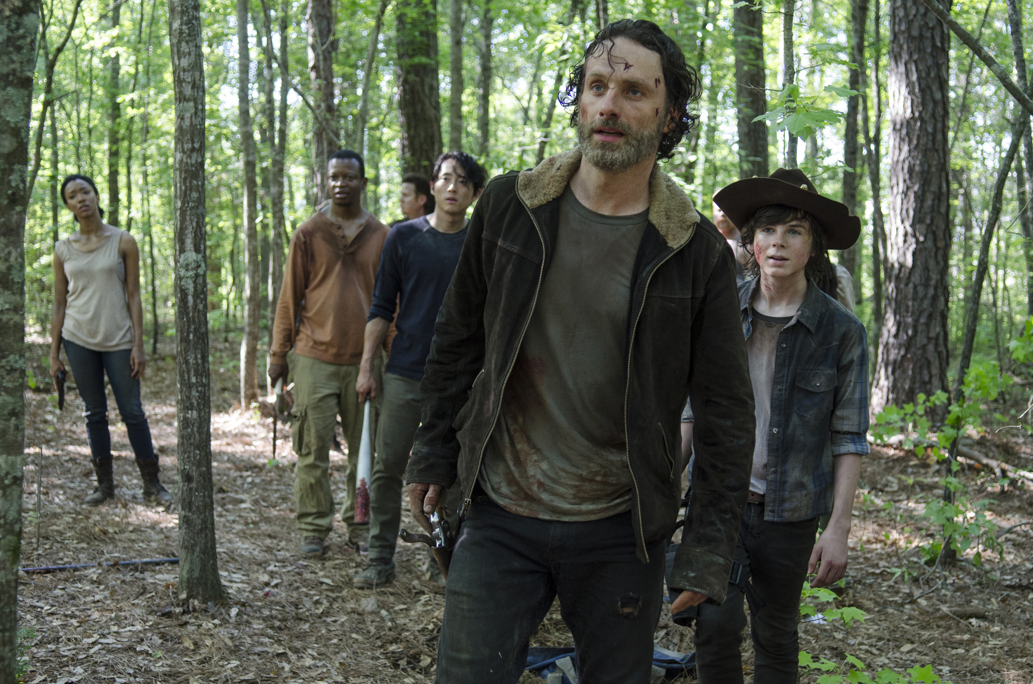 Sonequa Martin-Green as Sasha, Lawrence Gilliard Jr. as Bob Stookey, Josh McDermitt as Dr. Eugene Porter, Steven Yeun as Glenn Rhee, Andrew Lincoln as Rick Grimes and Chandler Riggs as Carl Grimes - The Walking Dead _ Season 5, Episode 1 - Photo Credit: Gene Page/AMC