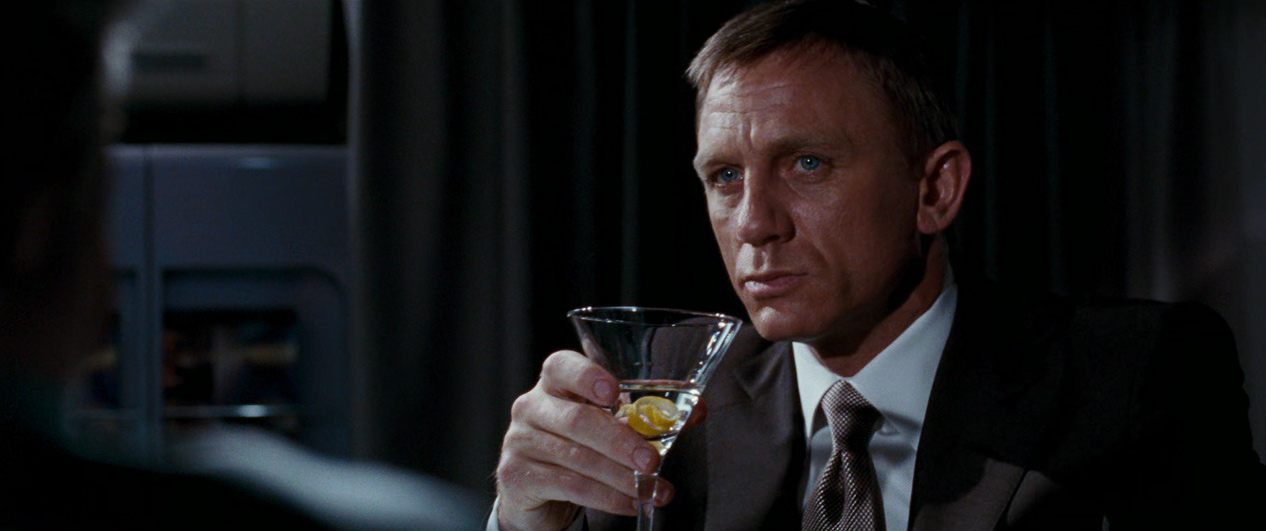 Daniel Craig as James Bond in Quantum of Solace, with a drink in hand.