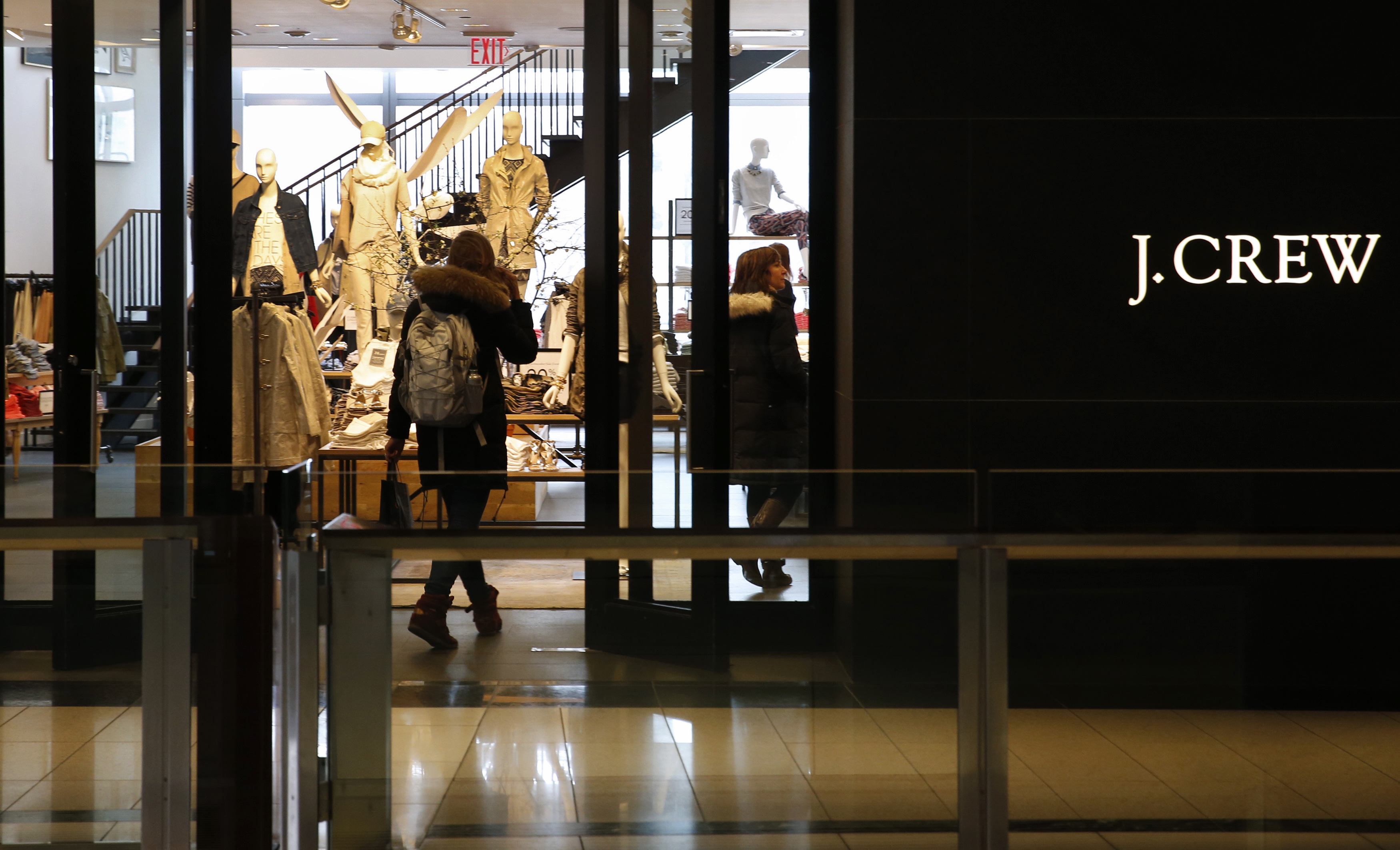 A customer walks into a clothing retailer J.Crew store in Manhattan, New York