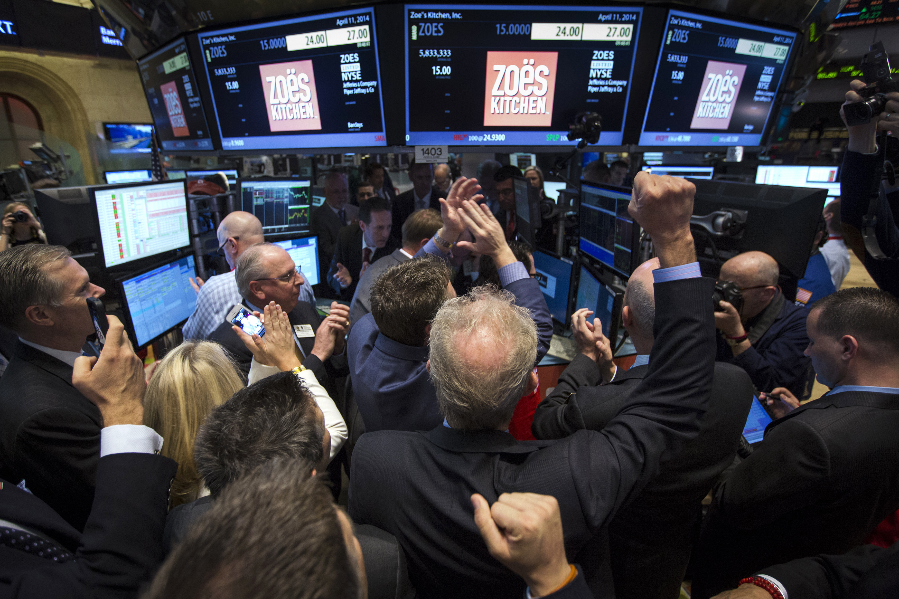 Traders, investors and guests celebrate as Zoe's Kitchen begins trading following the company's IPO at the NYSE