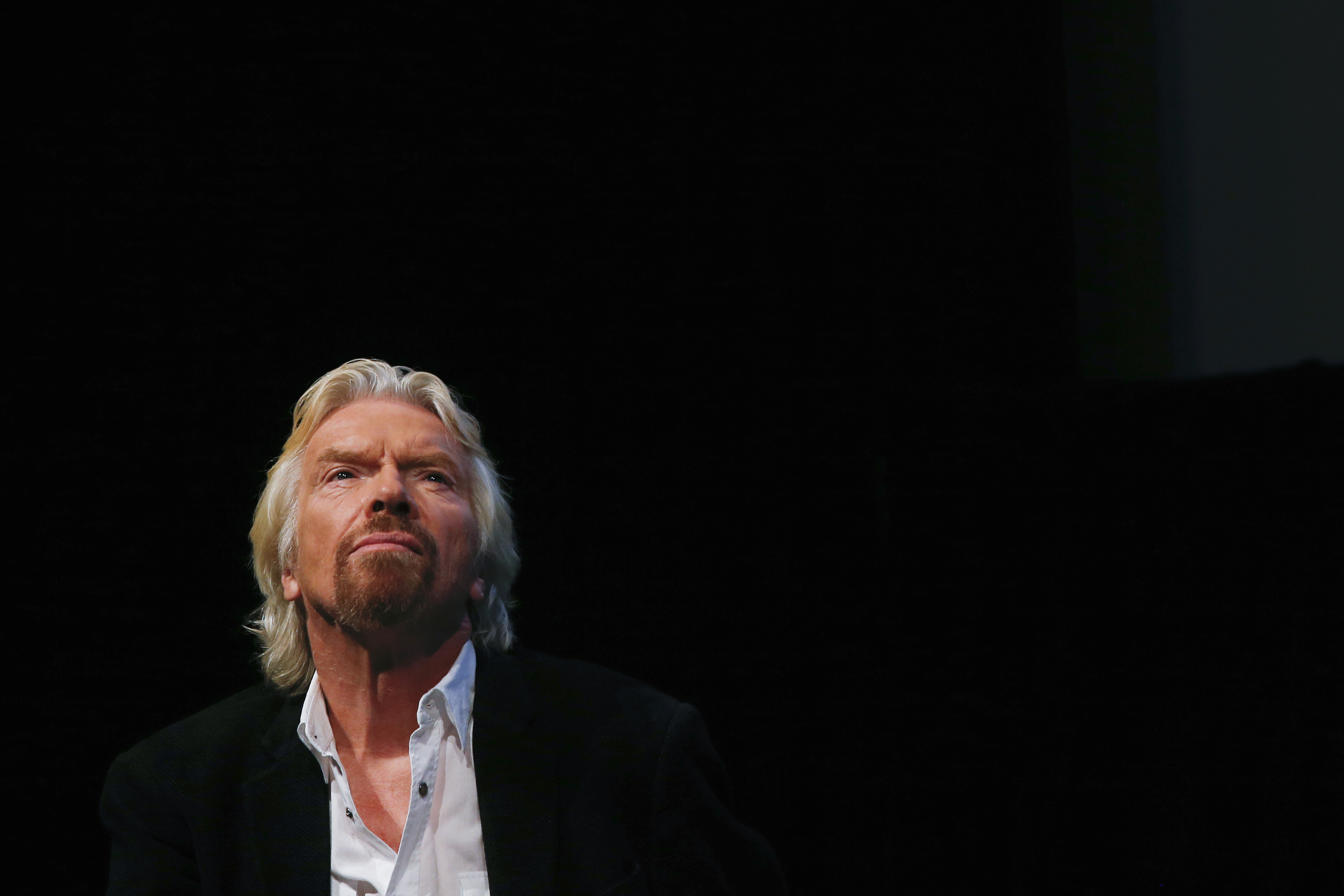 Sir Richard Branson listens to a speaker at the Global Commission on Drug Policy in New York