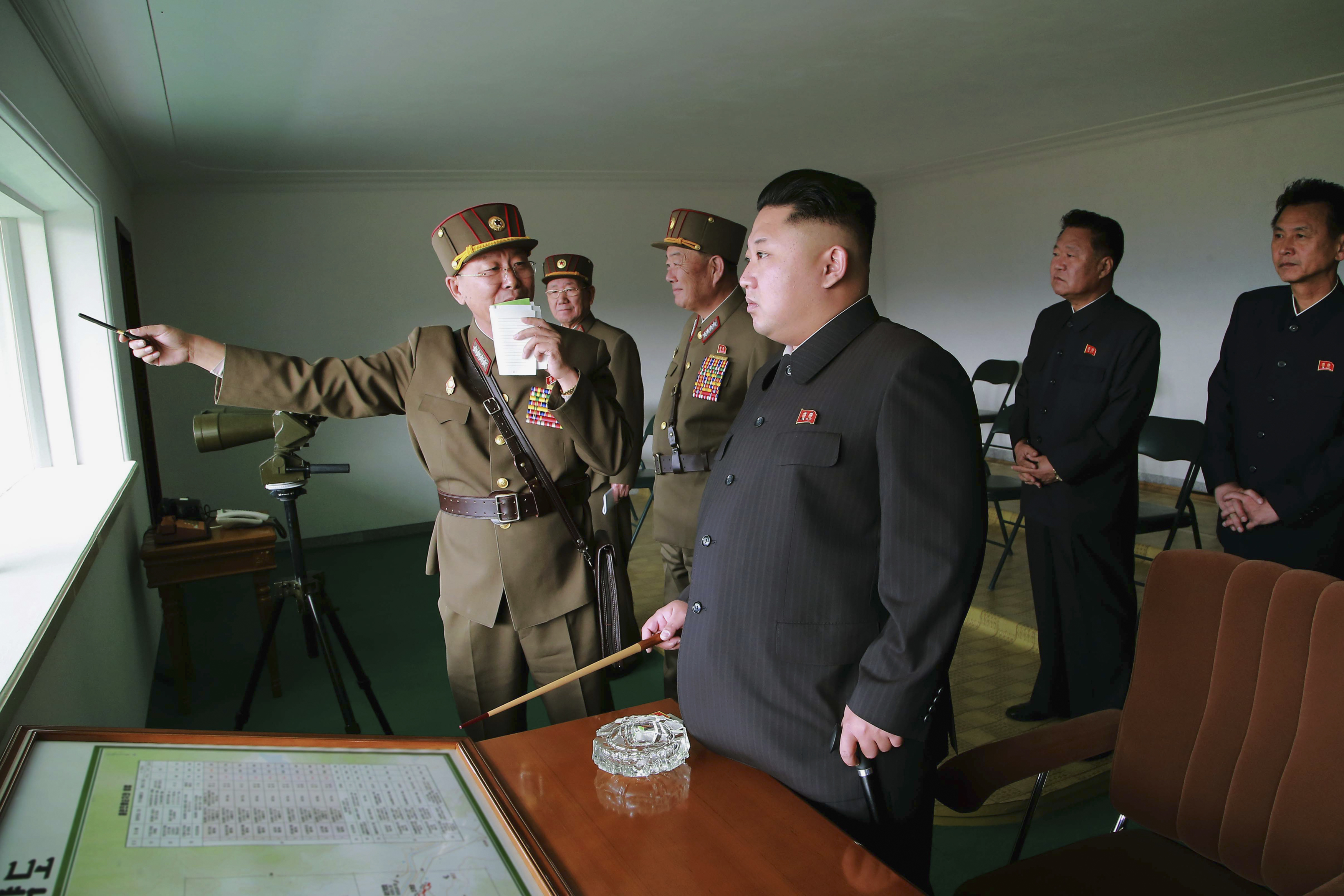 North Korean leader Kim Jong-Un attends a military drill between KPA Large Combined Unit 526 and KPA Combined Unit 478