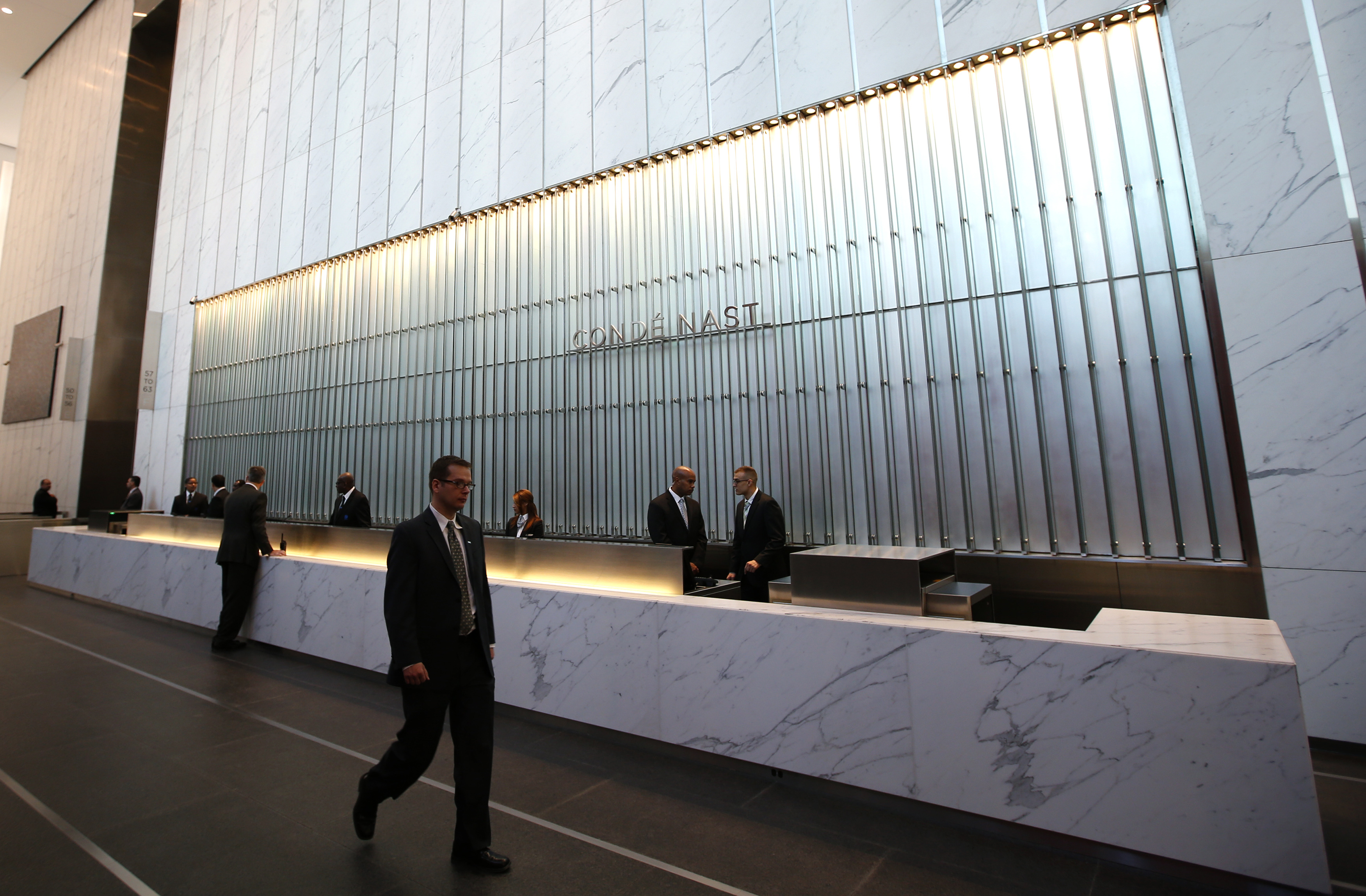 Conde Nast employees work in the lobby of the One World Trade Center tower in New York
