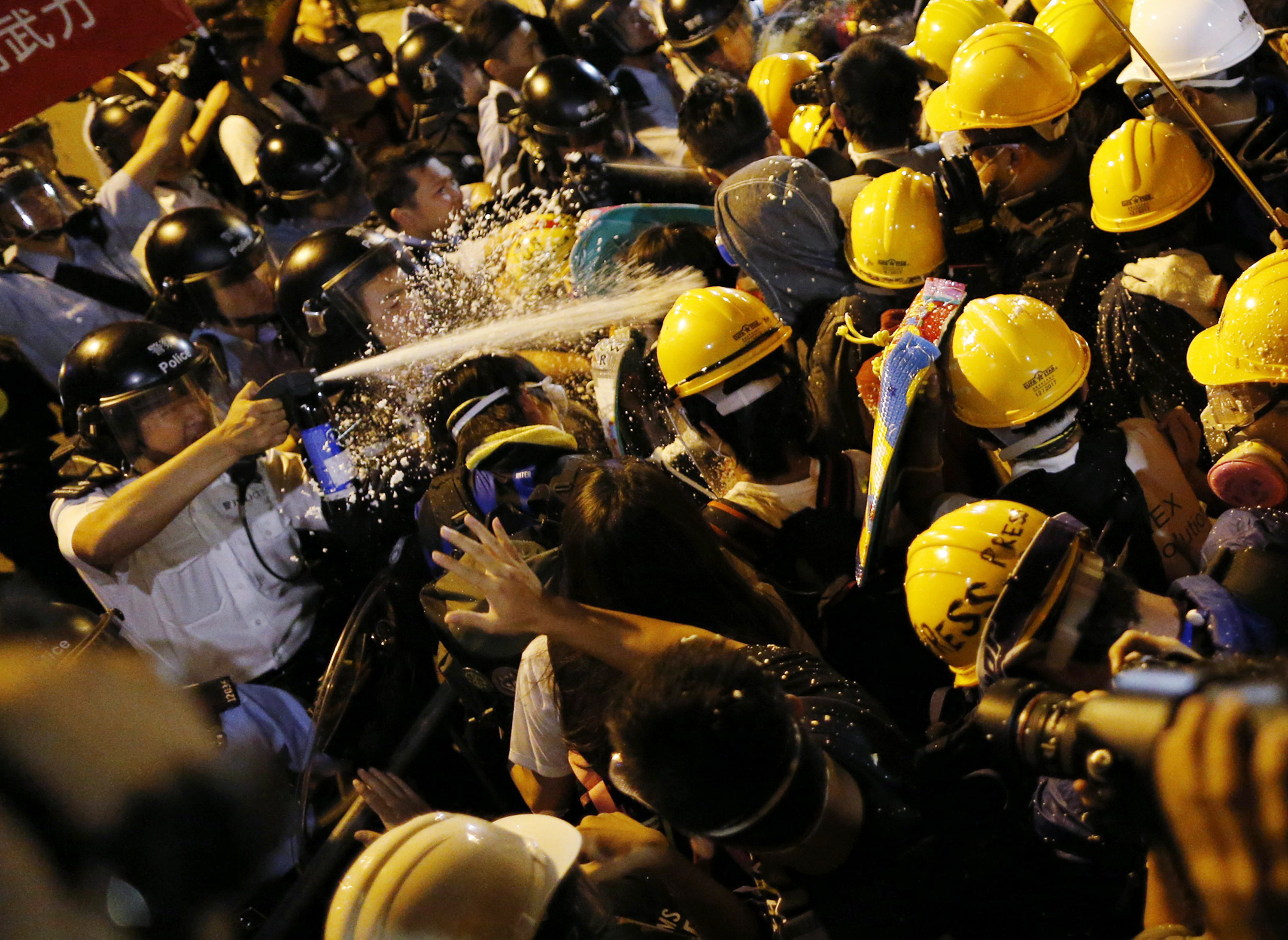 Police use pepper spray during clashes with pro-democracy protesters close to the chief executive office in Hong Kong