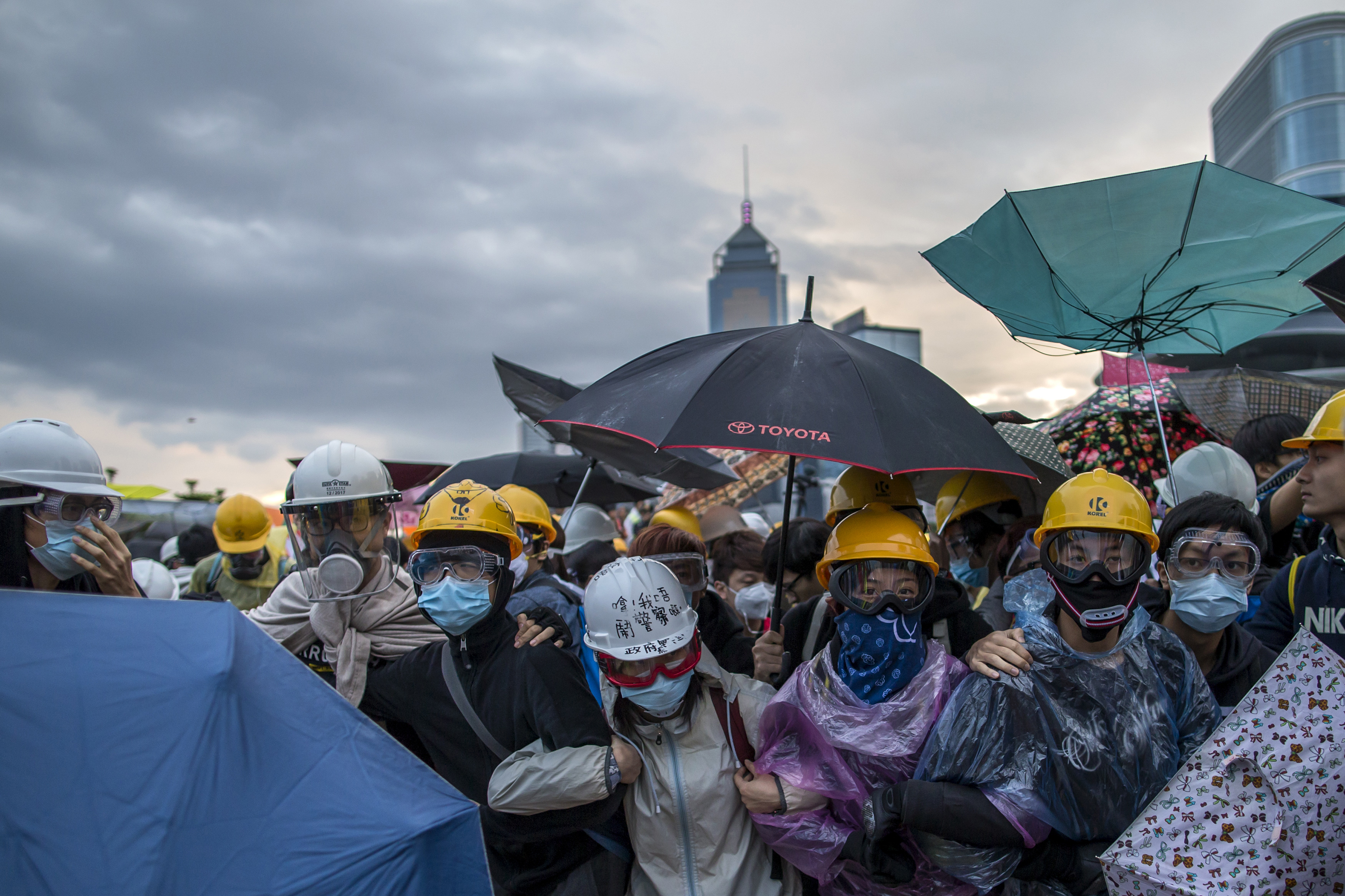 Pro-democracy protesters gather as police as riot police attempt to clear a demonstration site near the officer of the Chief Executive in Hong Kong