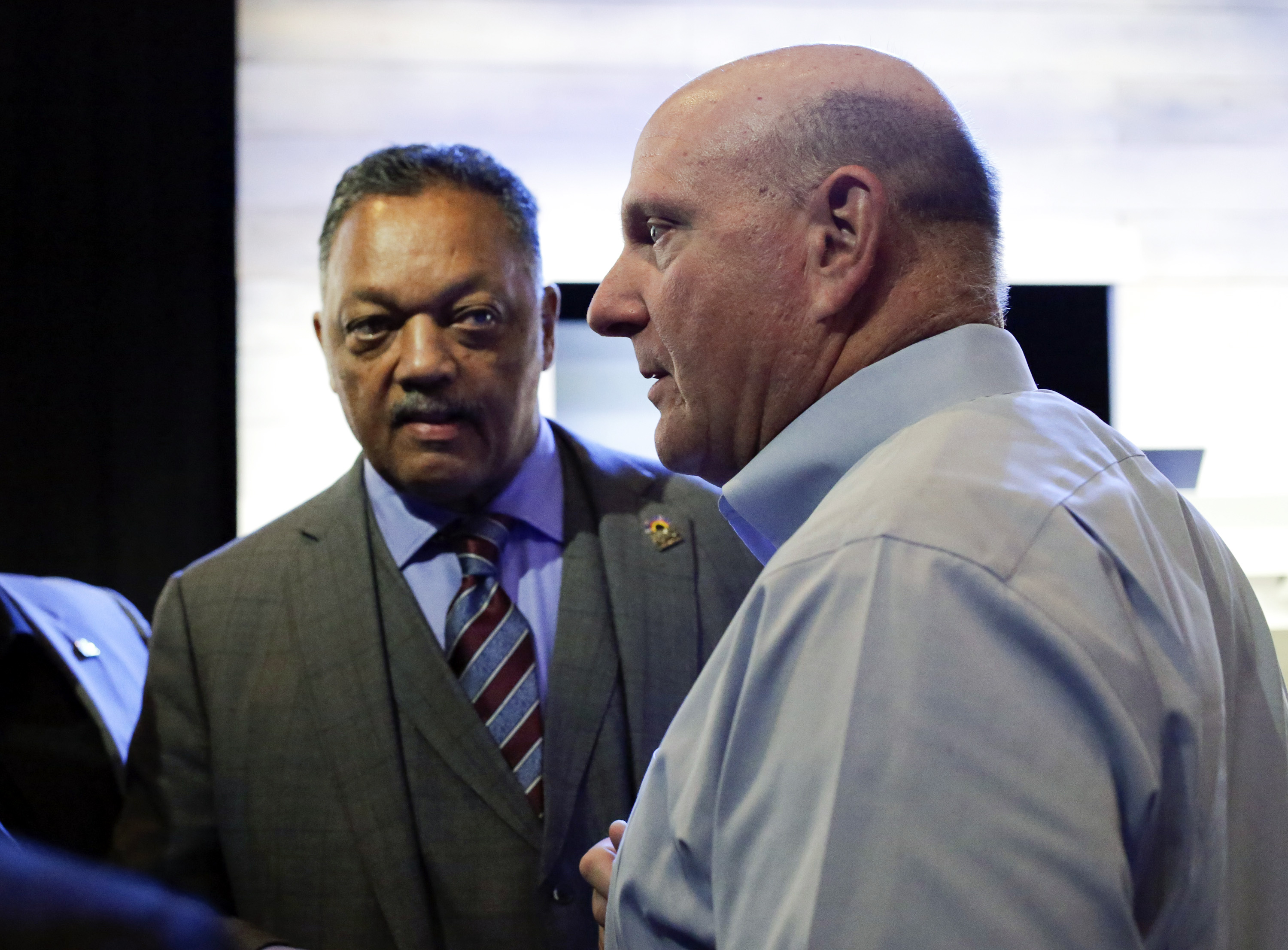 The Reverend Jesse Jackson and former Microsoft Corp Chief Executive Steve Ballmer attend the annual shareholders' meeting in Bellevue, Washington