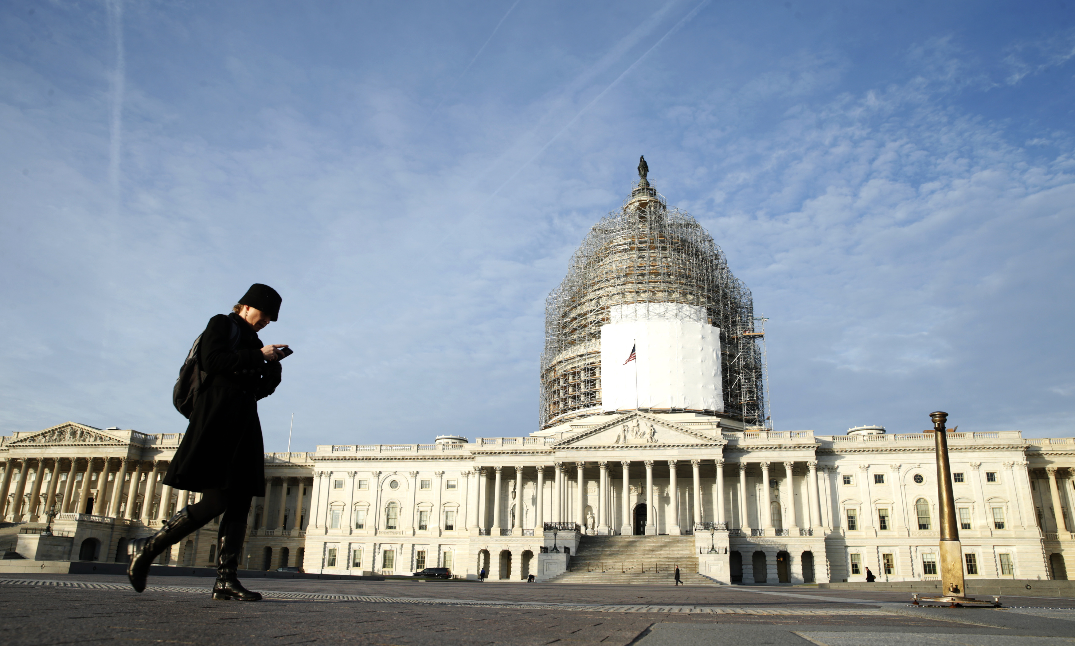 A woman walks past the U.S. Capitol in Washington