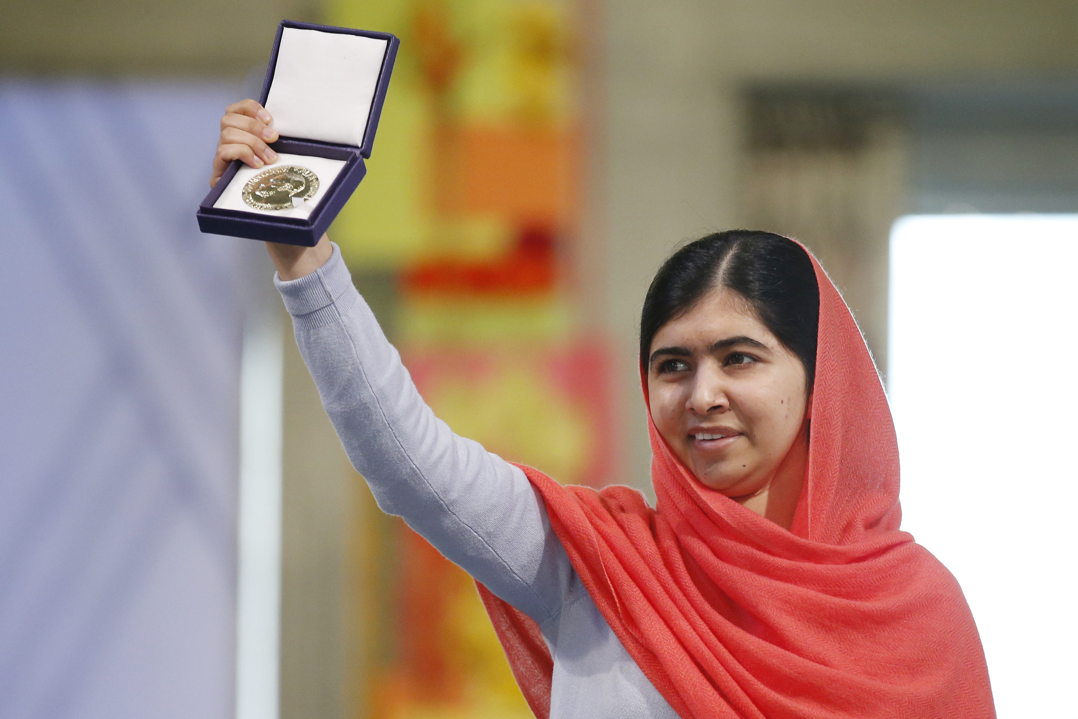 Malala Yousafzai holds her Nobel Peace Prize medal last December.