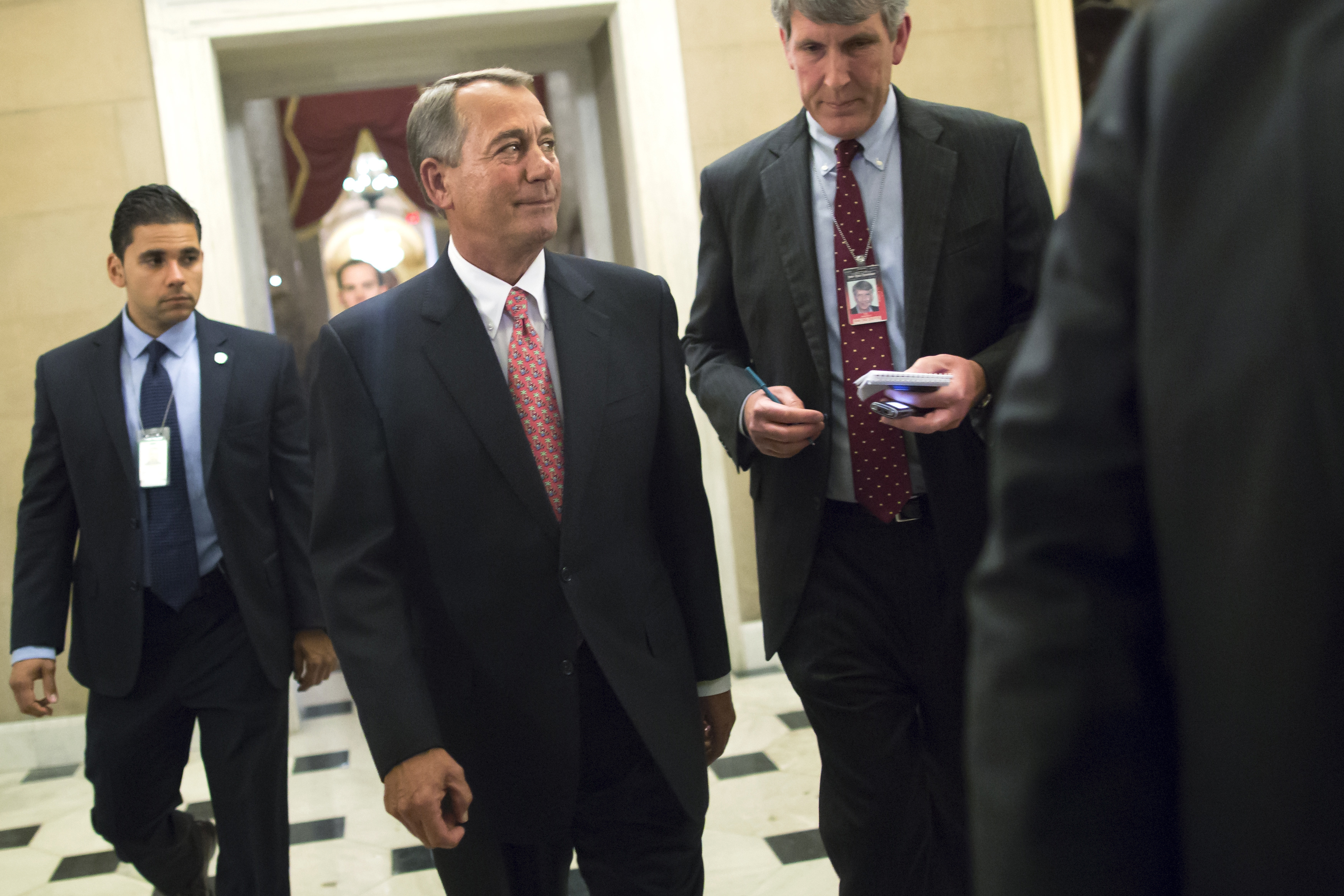Boehner walks to his office after passage of spending bill on the House floor at the U.S. Capitol in Washington