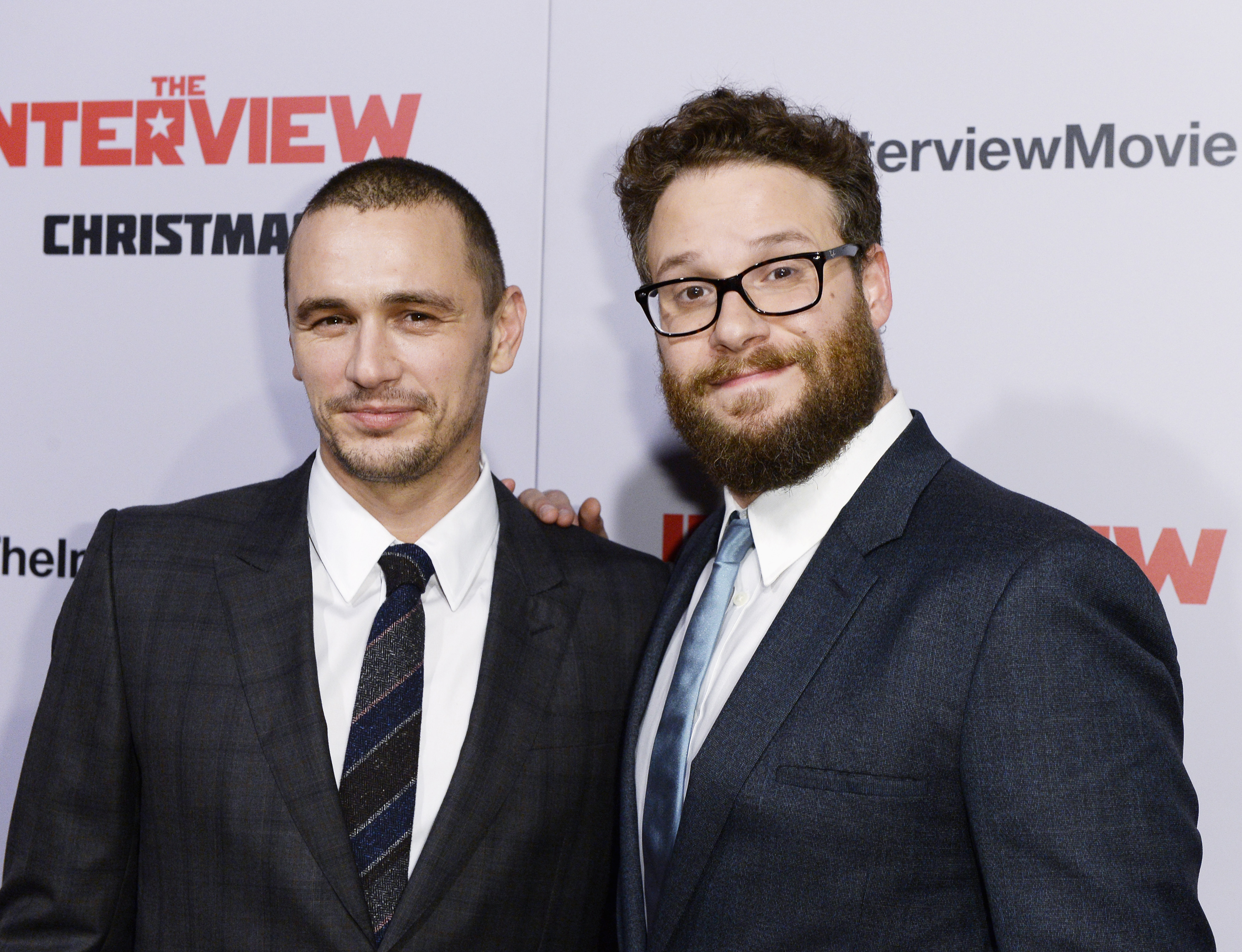 """Cast members James Franco and Seth Rogen pose during premiere of the film """"The Interview"""" in Los Angeles"""