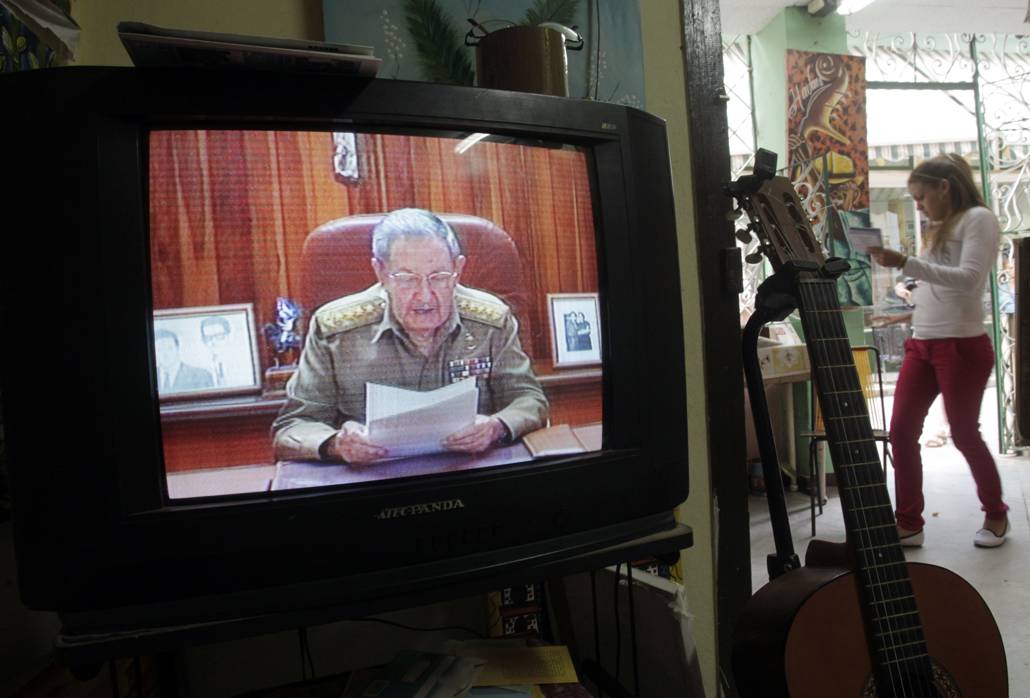 A television shows Cuba's President Raul Castro speaking during a television broadcast in Havana