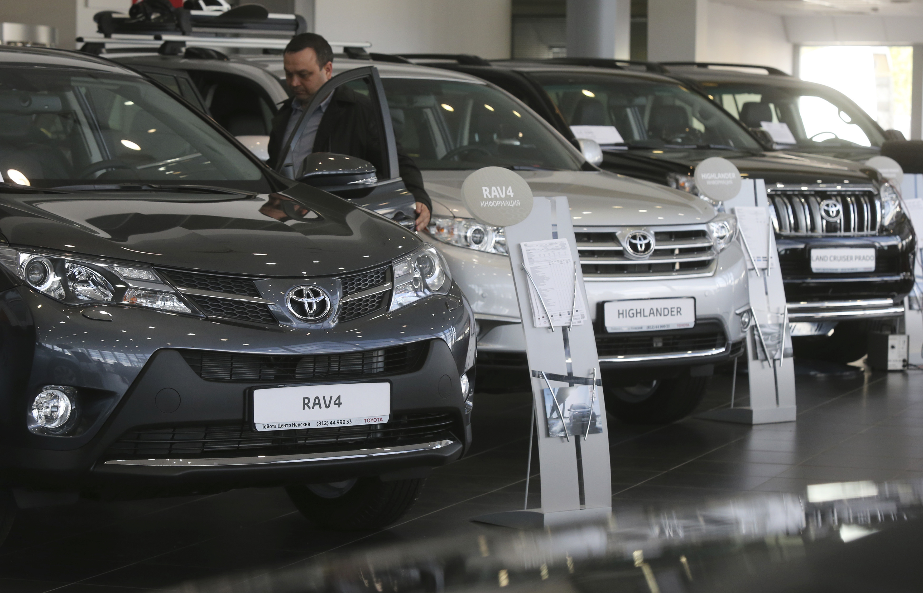 Automobiles are on display at a Toyota car sales and show room in St. Petersburg