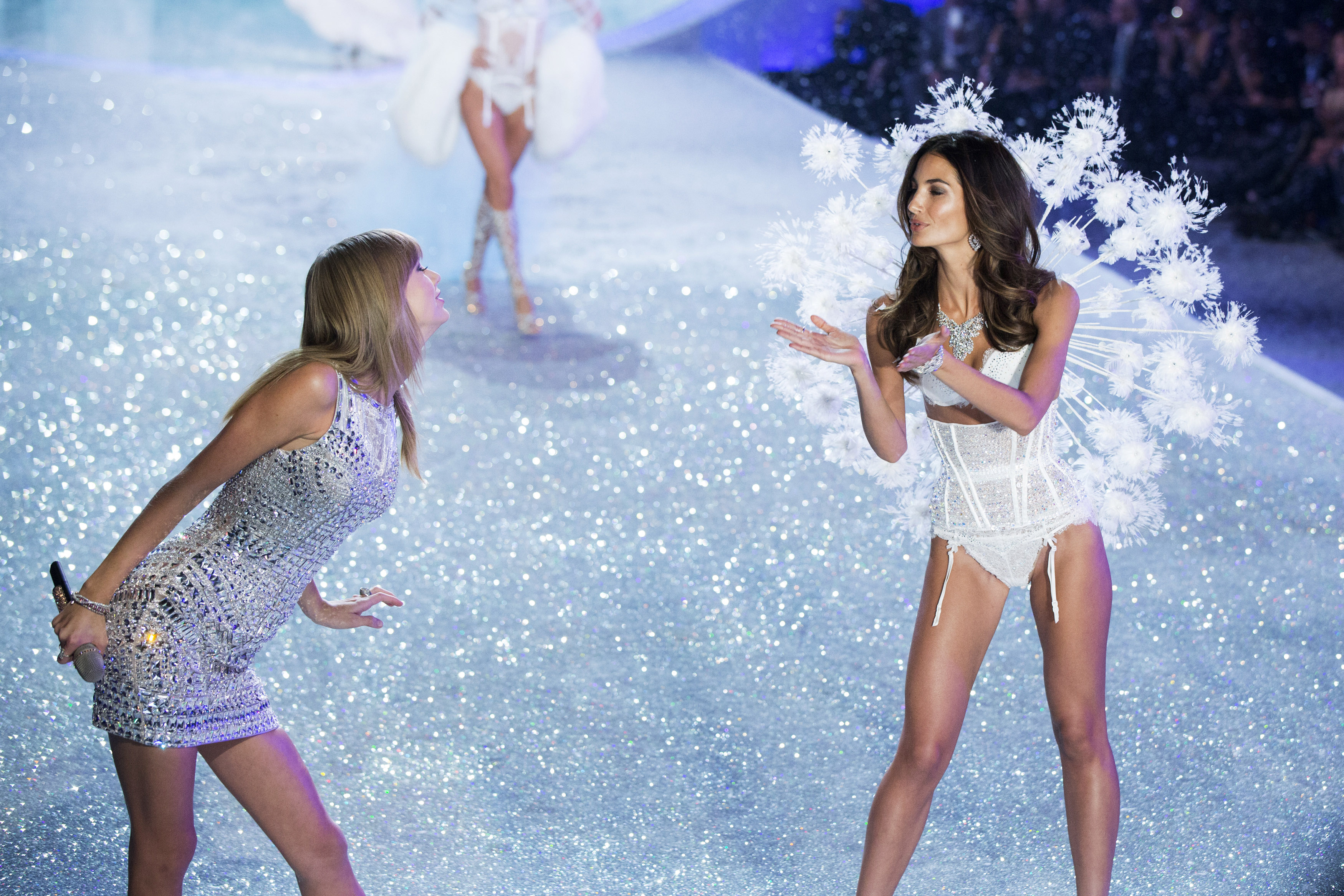 Swift gestures towards Aldridge as she presents a creation during the annual Victoria's Secret Fashion Show in New York