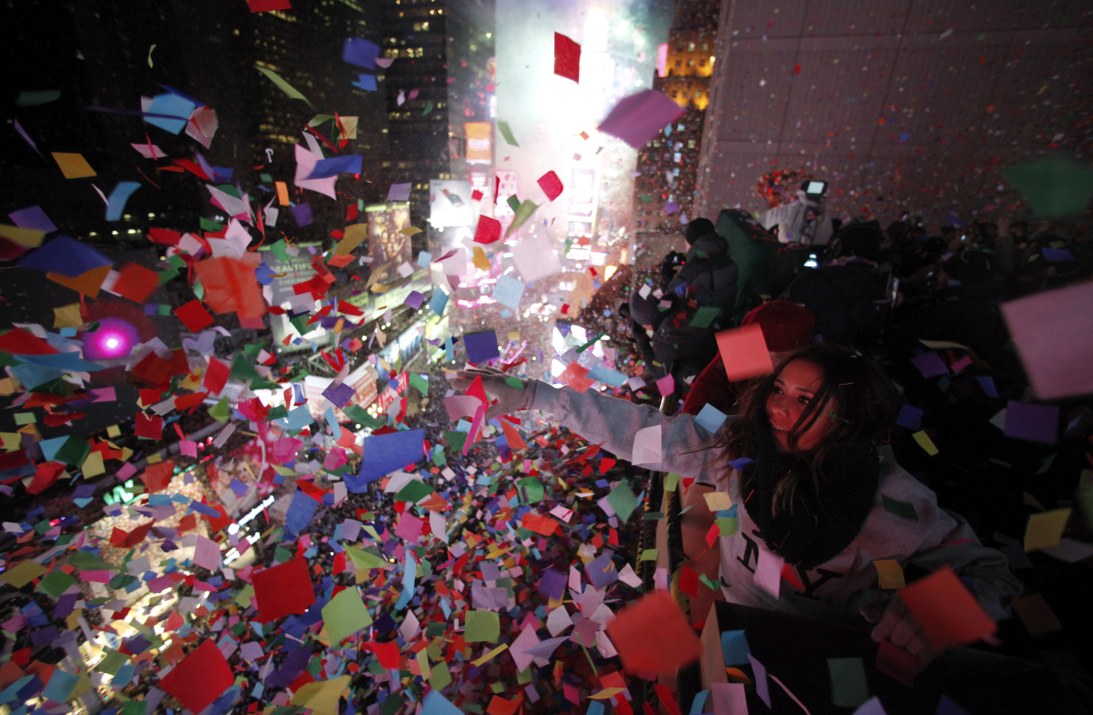 Confetti is dropped on revelers at midnight during New Year's Eve celebrations in Times Square in New York