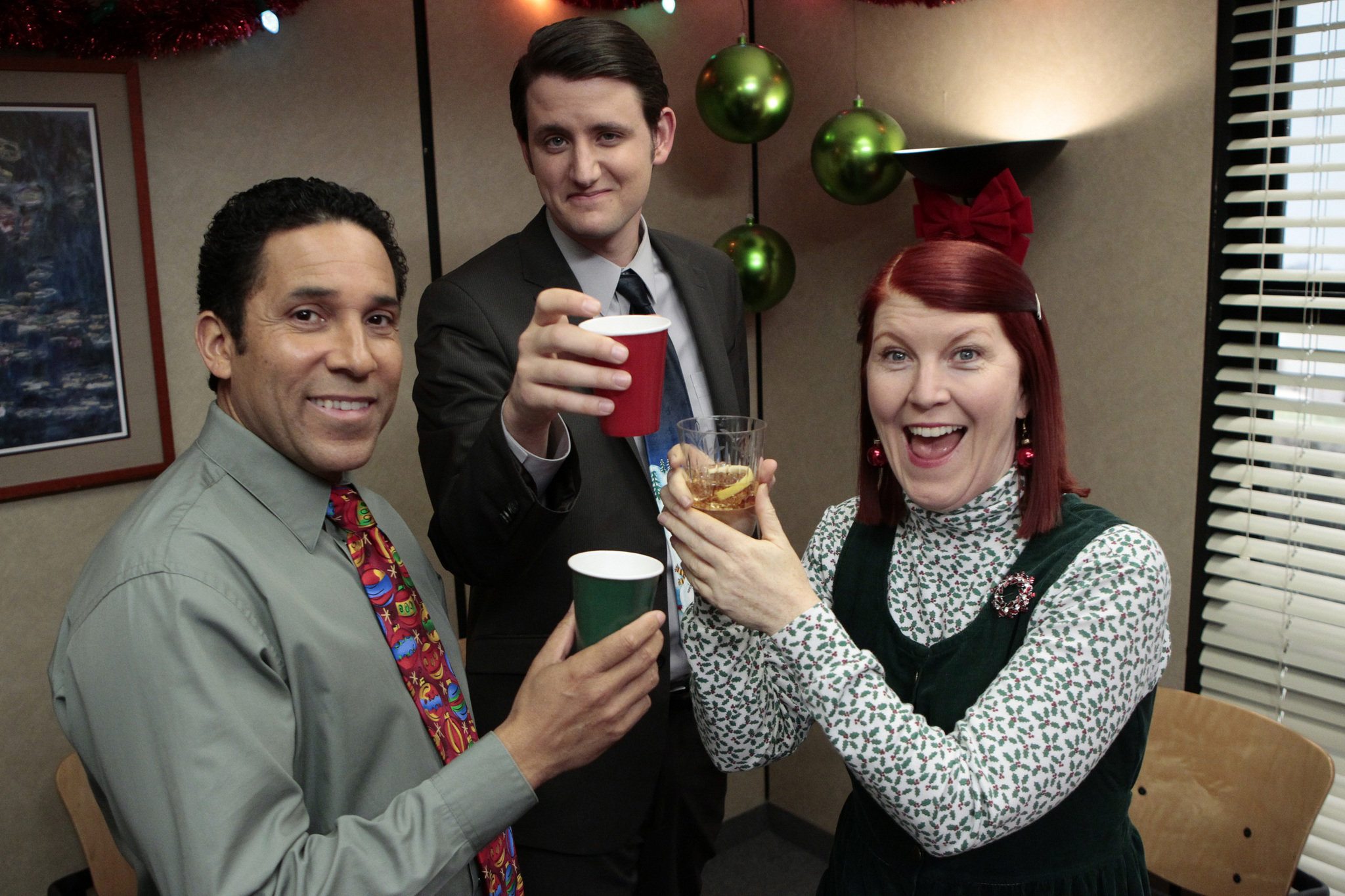 Oscar Nuñez as Oscar Martinez, left, Zach Woods as Gabe Lewis and Kate Flannery as Meredith Palmer in NBC's 'The Office.'