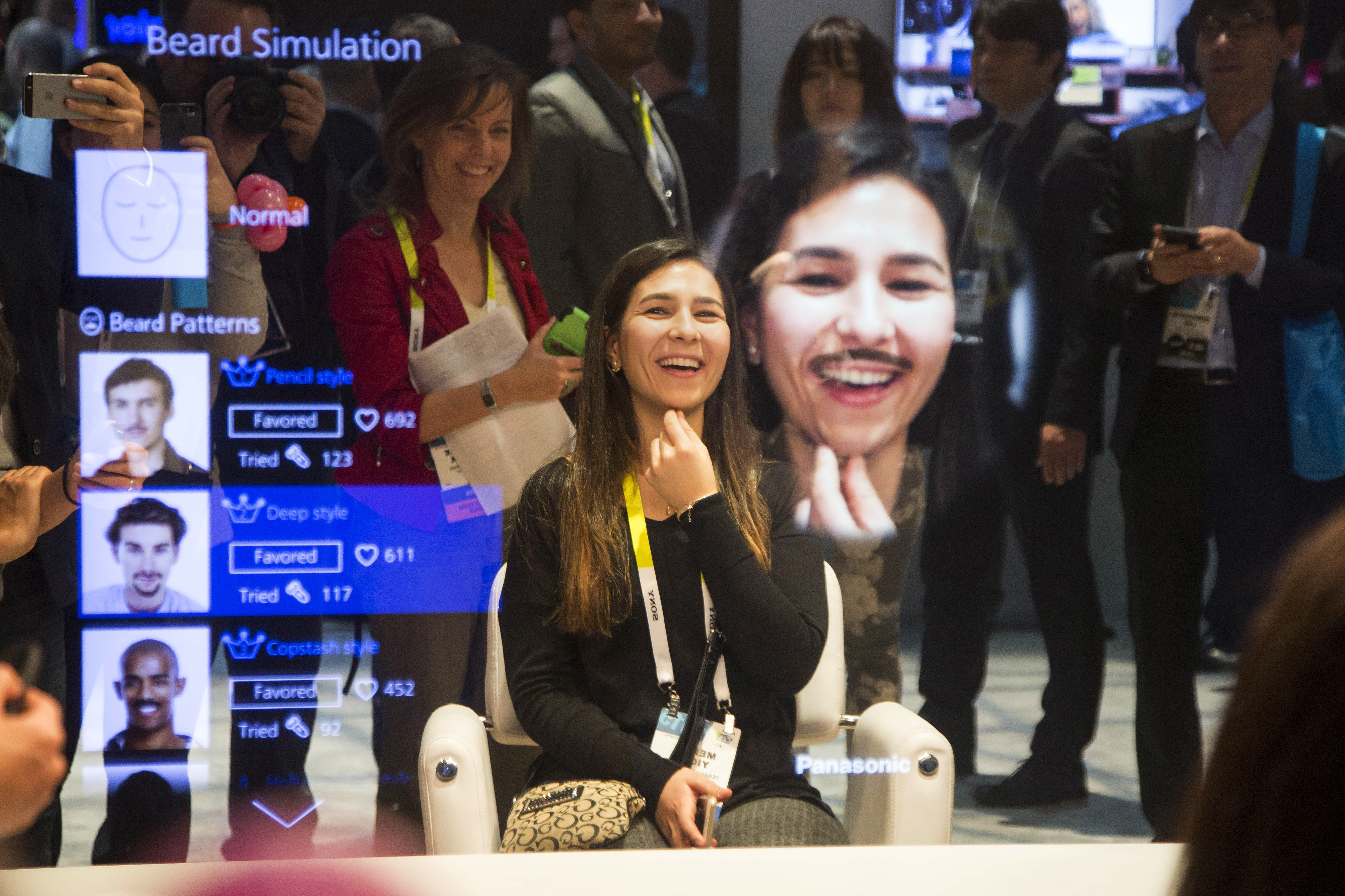An attendee tries out the beard simulation effect on a Panasonic Corp. Smart Mirror during the 2015 Consumer Electronics Show in Las Vegas, on January 6, 2015.