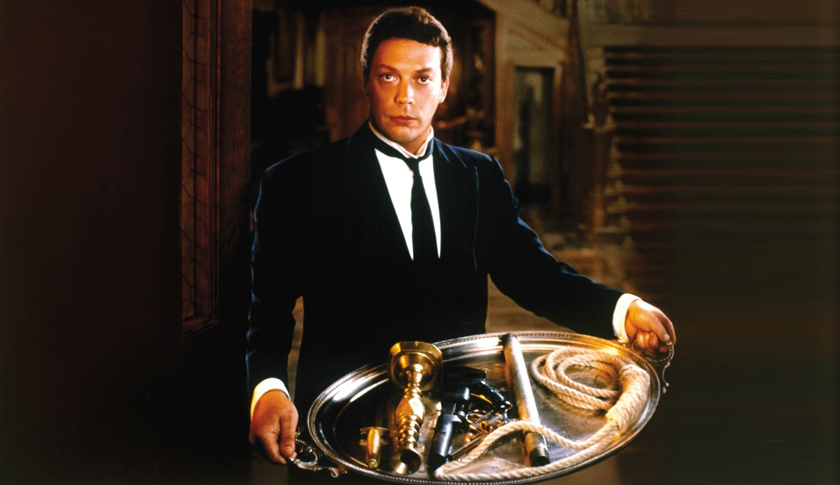 Tim Curry as Wadsworth in the movie Clue.