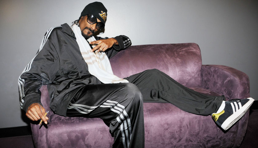WHAT' S THAT YOUR SMOKING SNOOP? Rapper Snoop Dogg is spotted smoking a suspicious looking cigarette backstage at the Nokia Theatre in Los Angeles