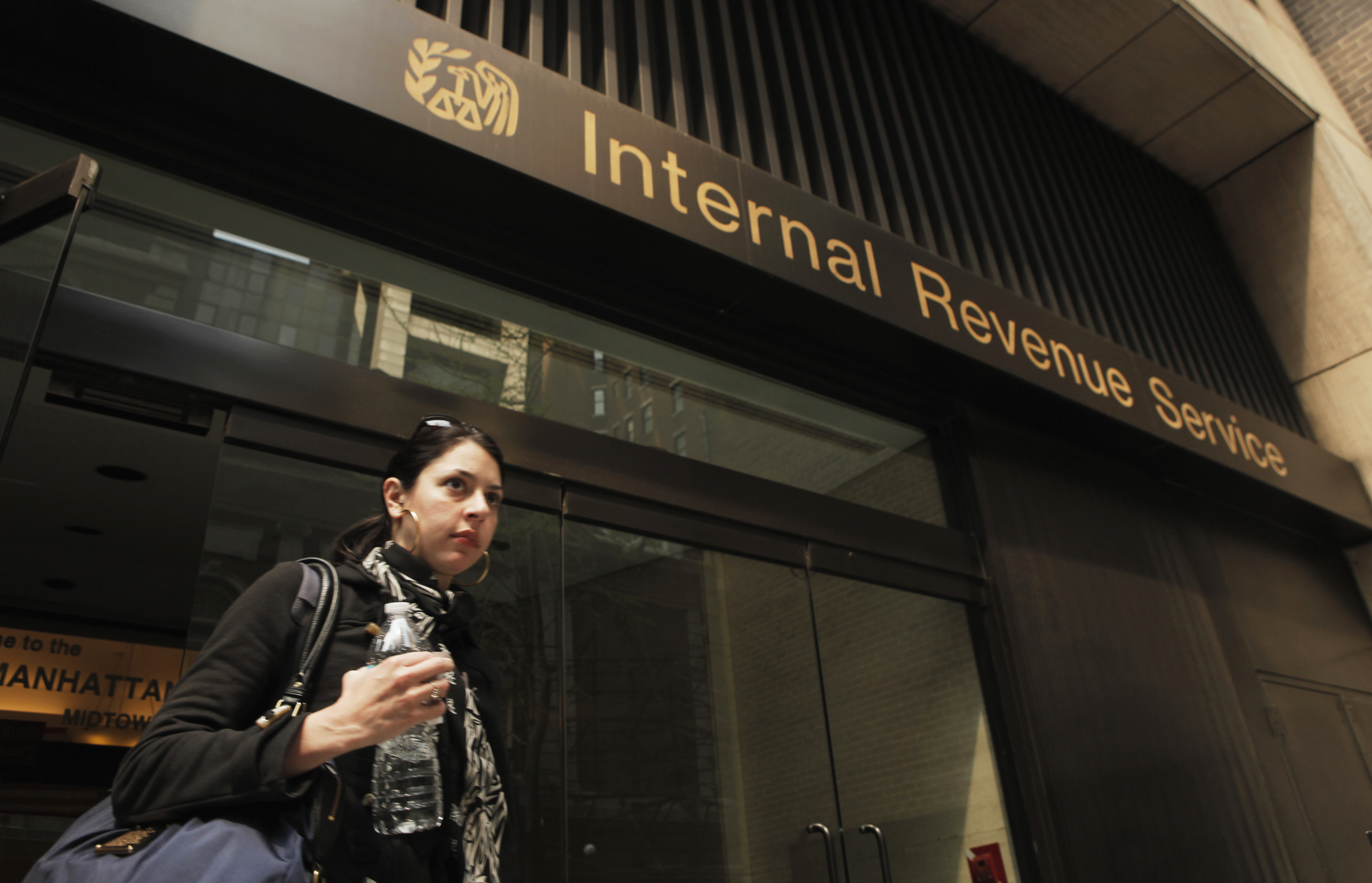 A woman walks out of an Internal Revenue Service office in New York