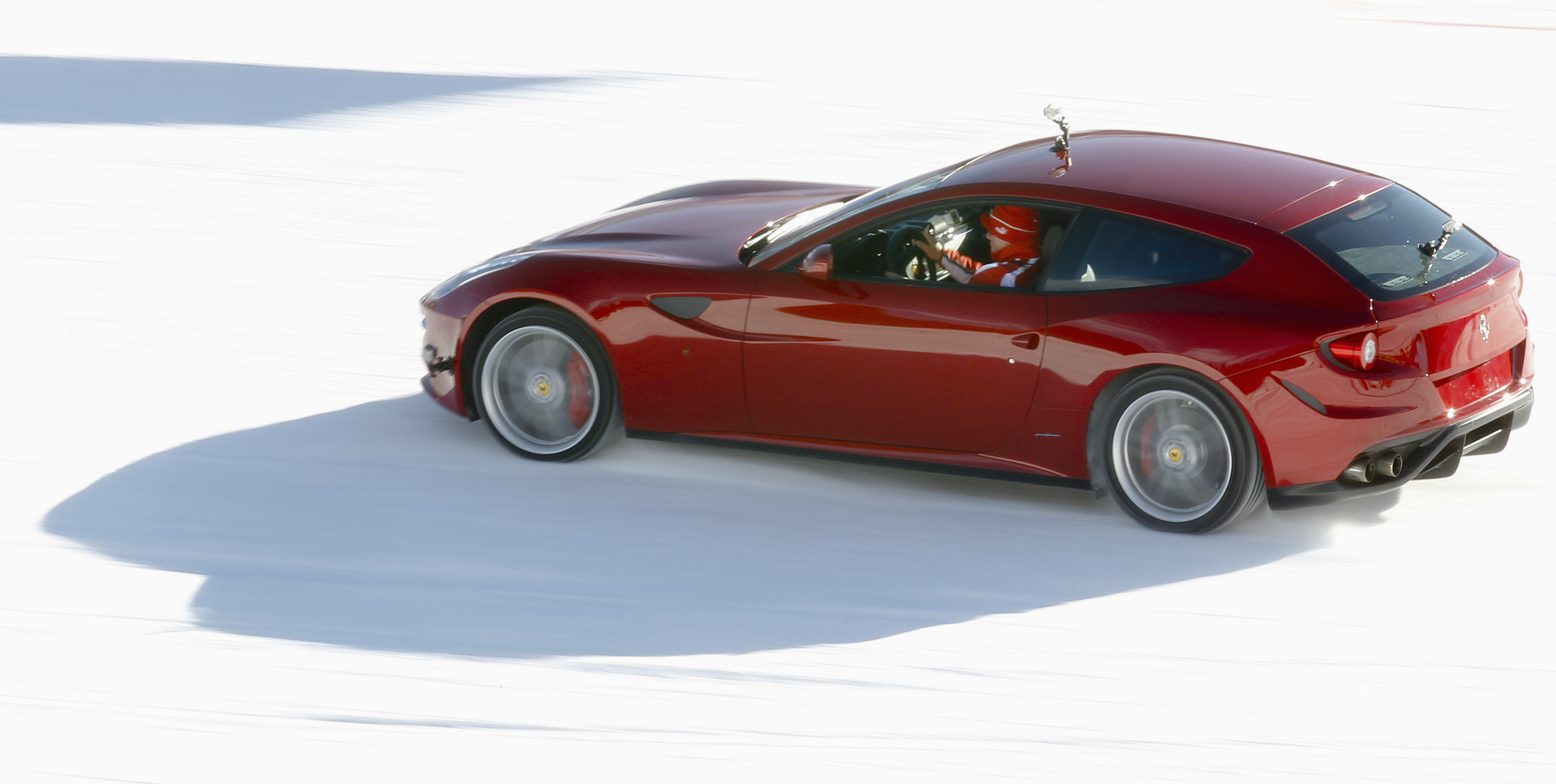 """A new model of Ferrari FF car is seen as it races on the snow during the """"Wrooom, F1 and MotoGP Press Ski Meeting"""" in Madonna di Campiglio"""