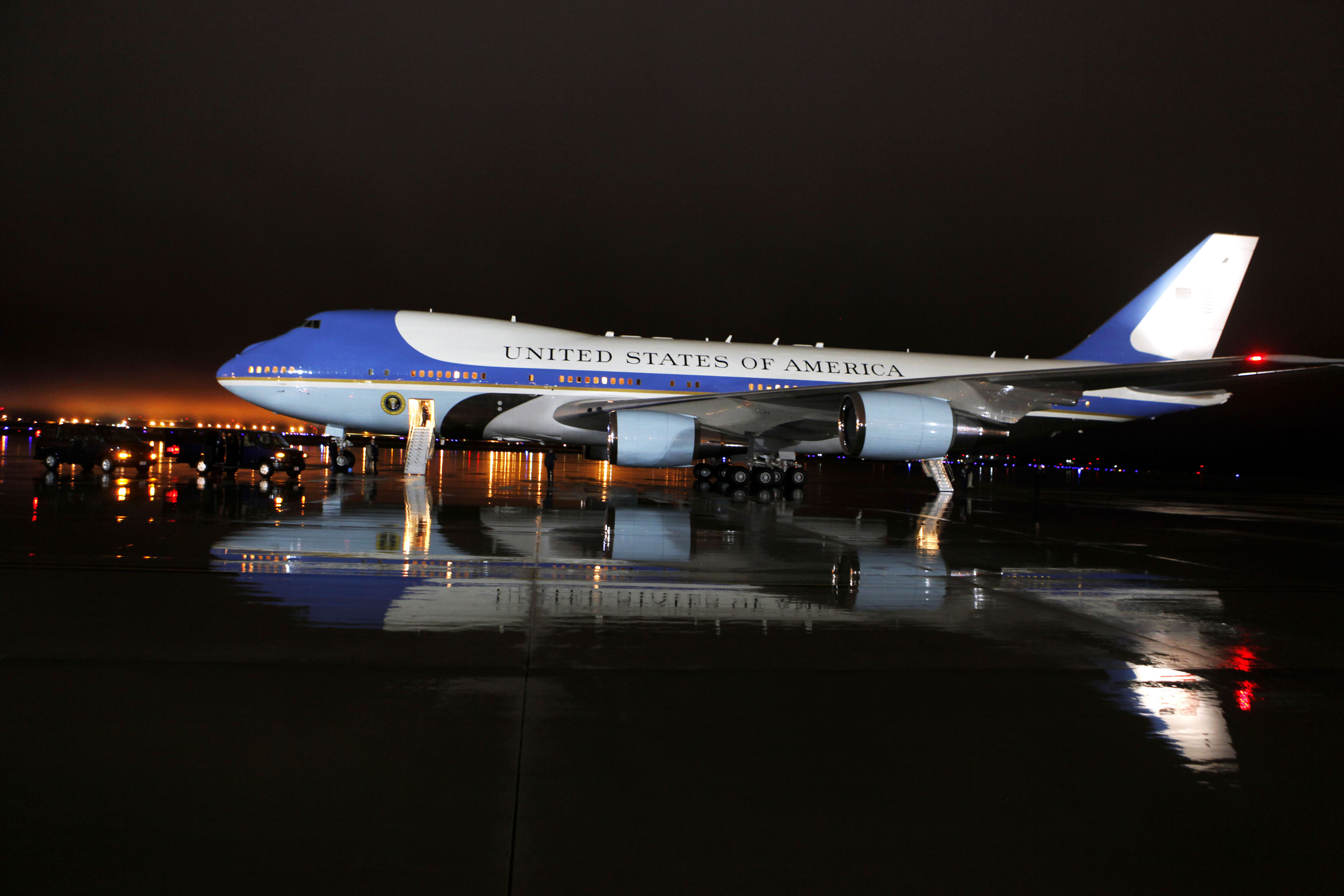 Air Force One sits on the rainy tarmac at Joint Base Andrews after a rainstorm blew through the Washington region after midnight