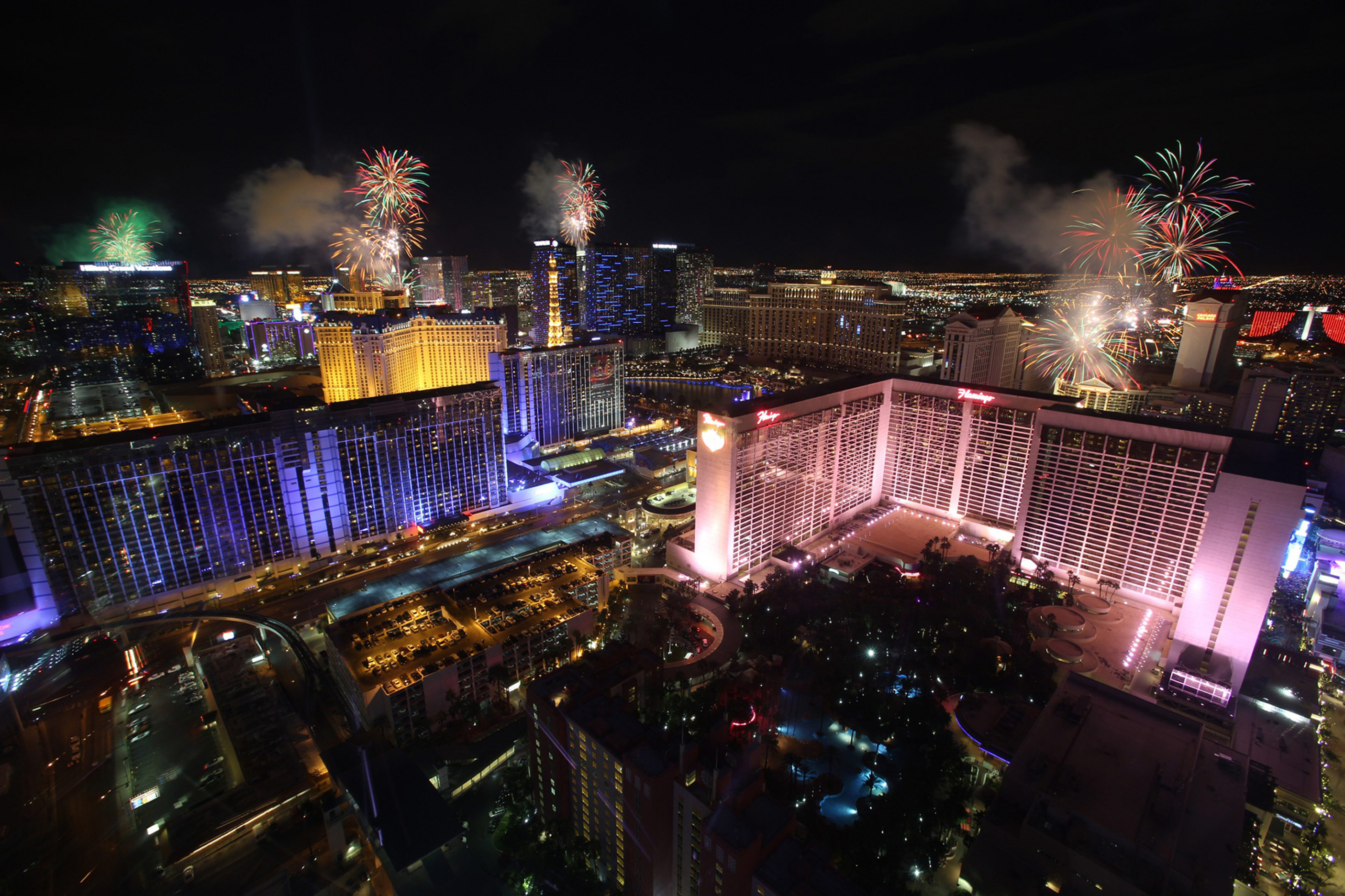 New Year's fireworks explode over Las Vegas Strip casinos in this view from the High Roller observation wheel in Las Vegas