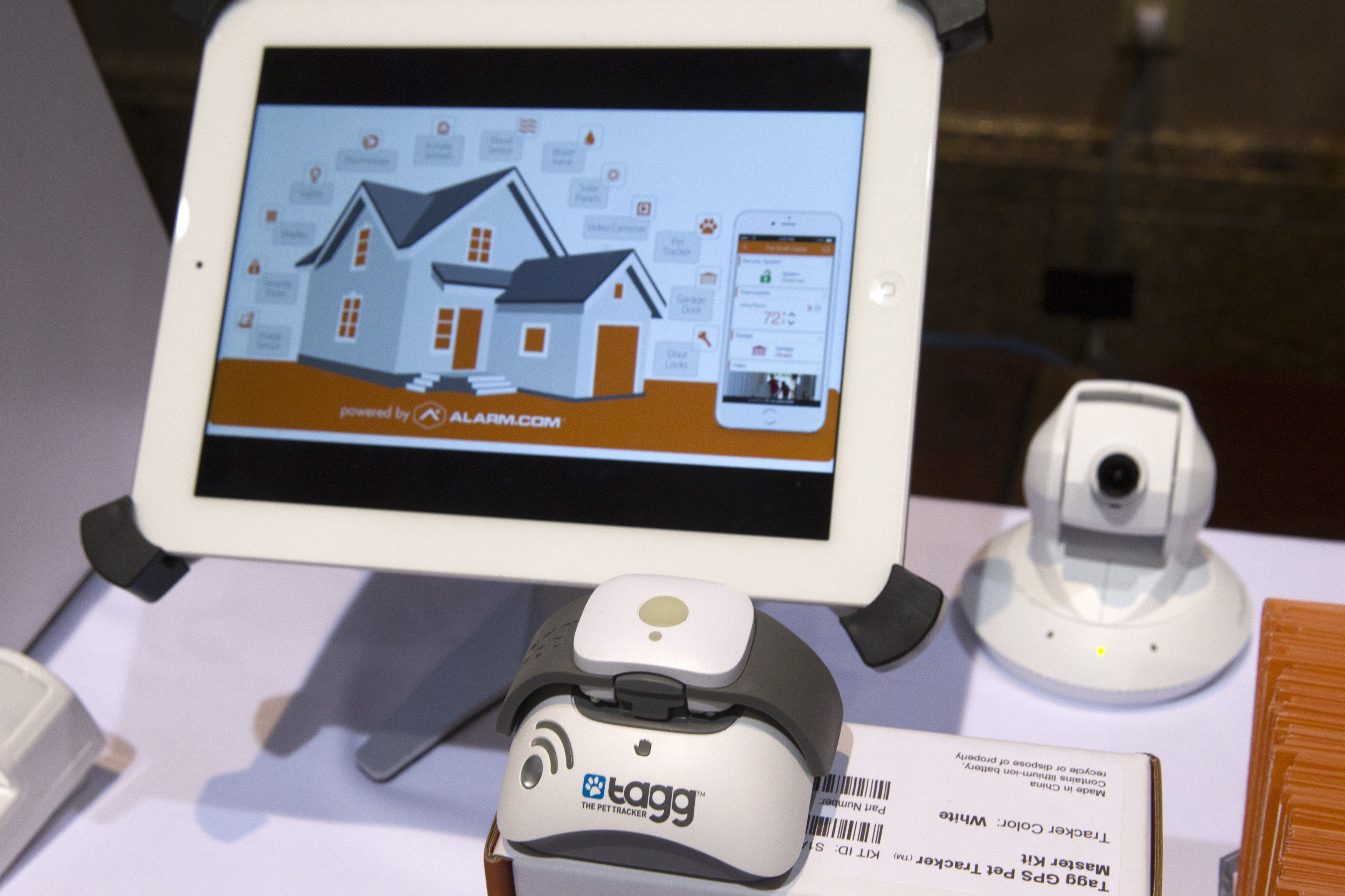 Tagg pet tracker at shown in an Alarm.com booth during the 2015 International Consumer Electronics Show in Las Vegas