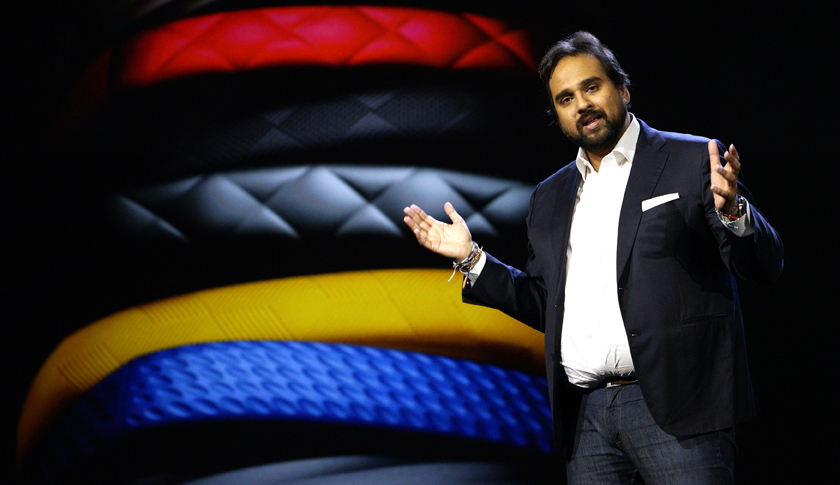 Rahman, CEO and co-founder of Jawbone, speaks during the Samsung keynote with Jawbone products displayed in the background at the International Consumer Electronics show in Las Vegas