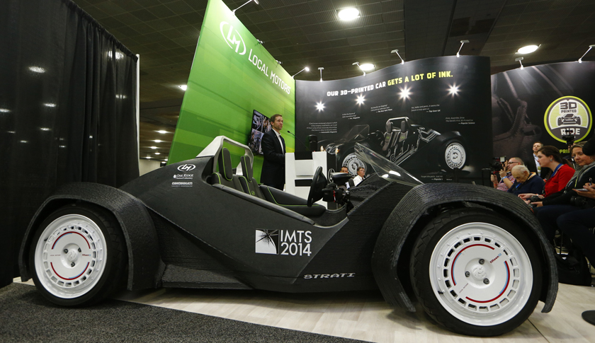 Local Motors showcase the world's first 3-D printed car during the first press preview day of the North American International Auto Show (NAIAS) in Detroi