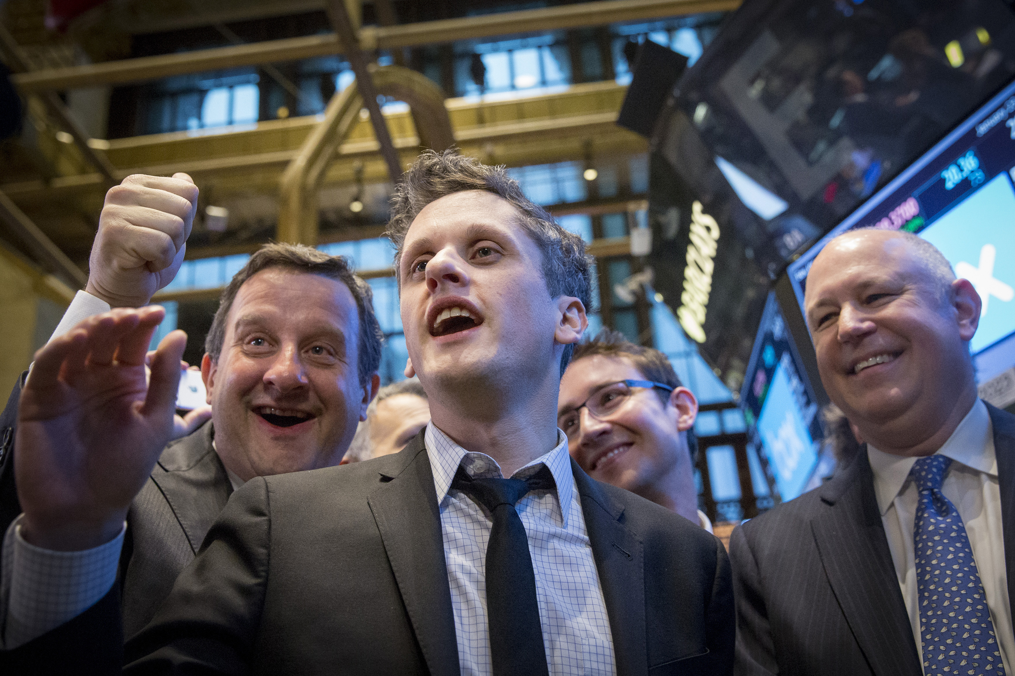 Box Inc Co-Founder and CEO Levie and Co-Founder and CFO Smith celebrate their company's IPO on the floor of the New York Stock Exchange