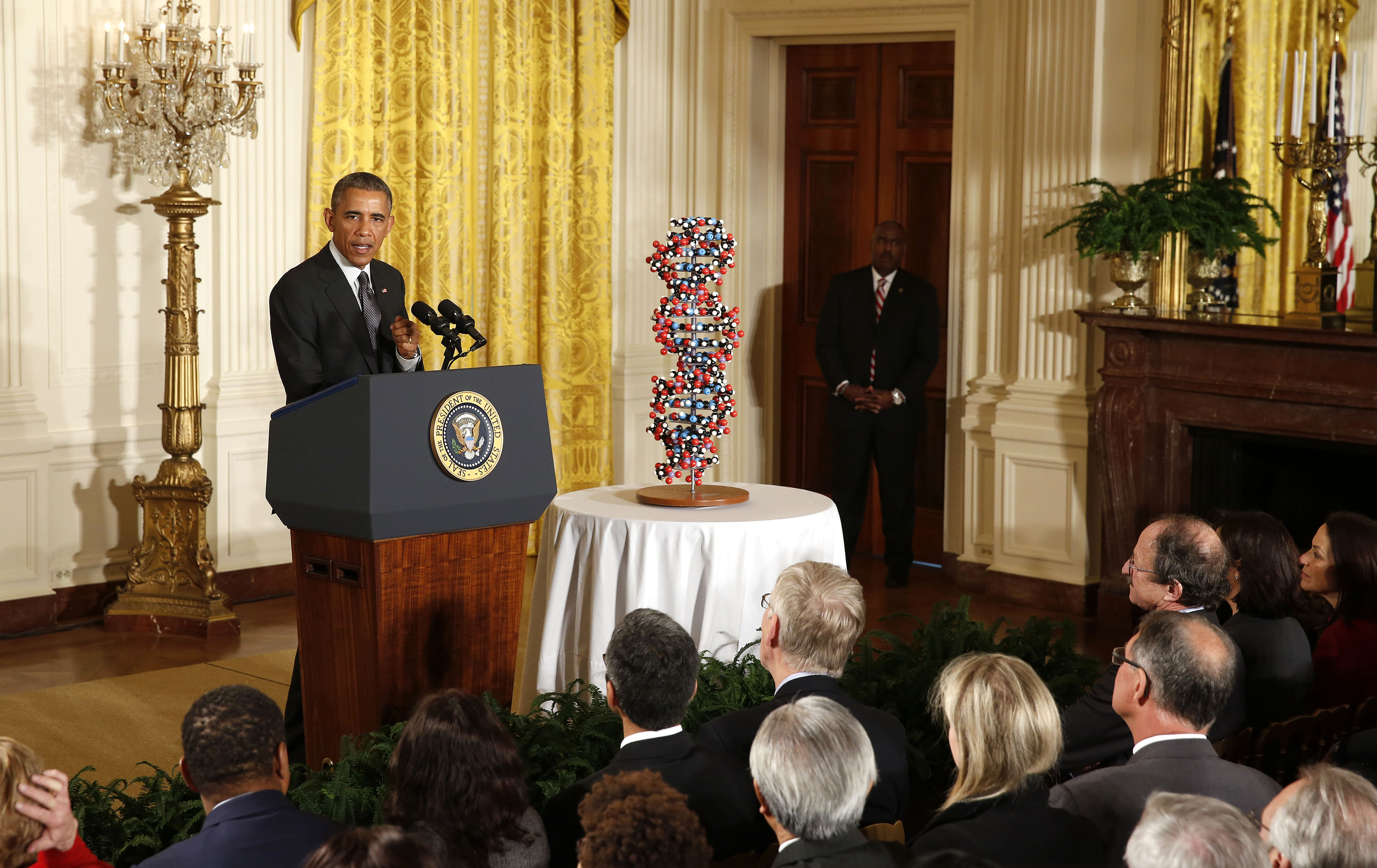 Obama talks about investments to improve health and treat disease through precision medicine while in the East Room of the White House in Washington