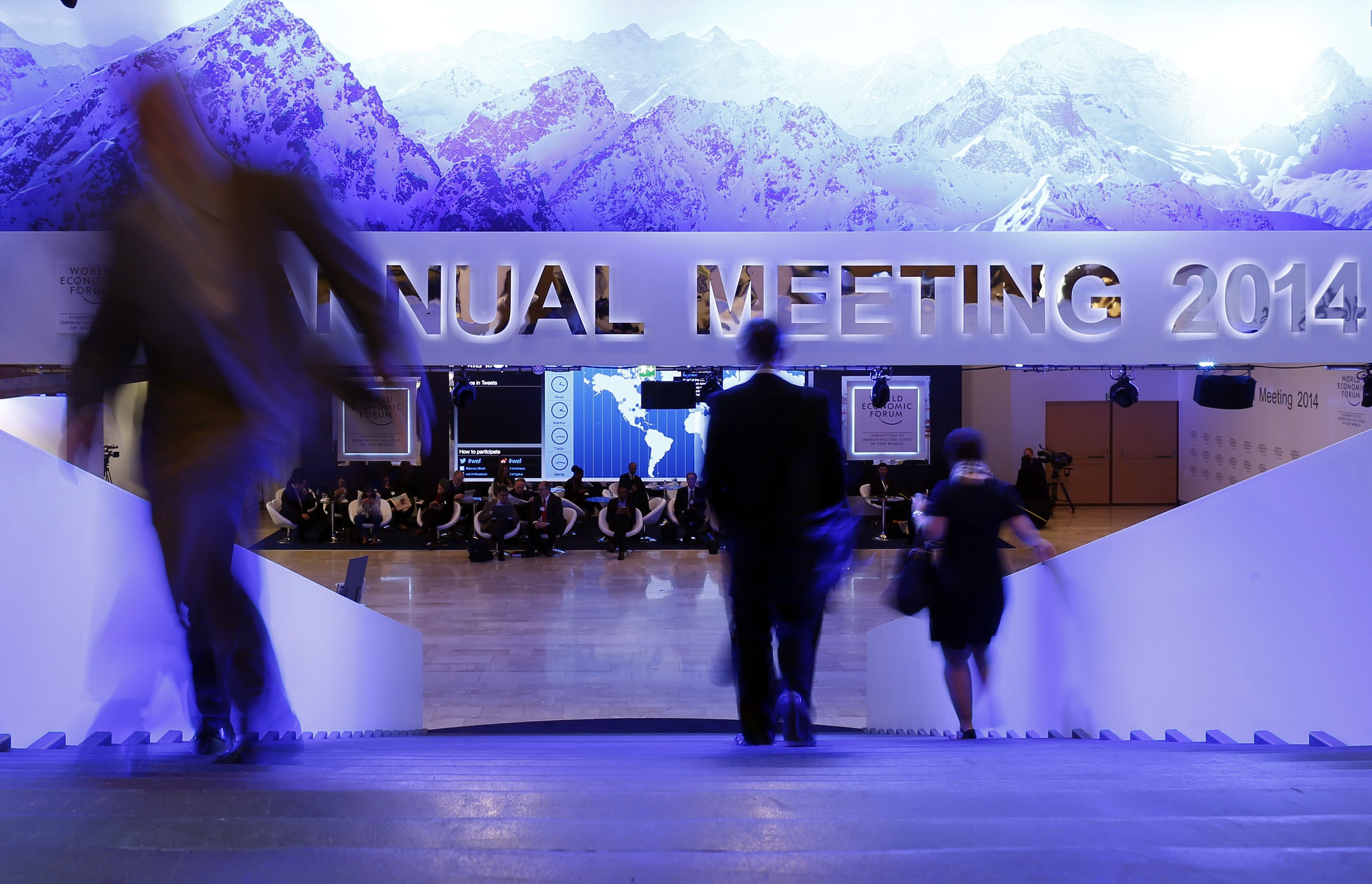 Participants take a break between sessions of World Economic Forum in Davos
