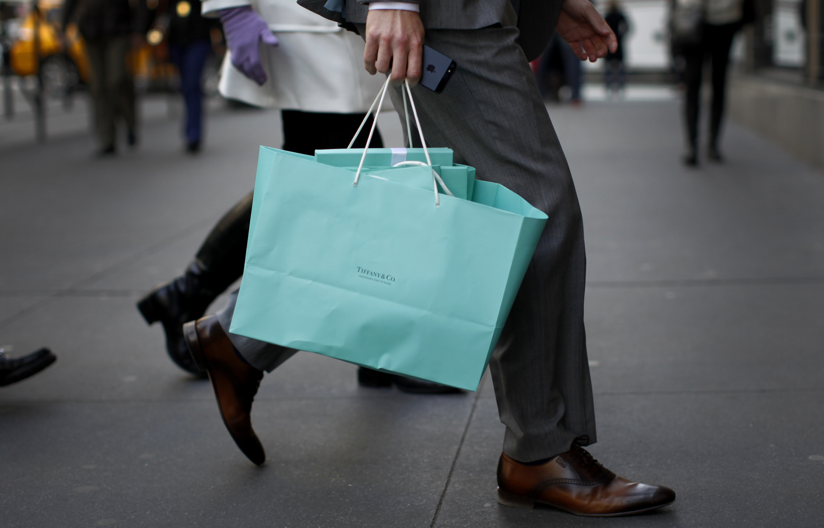 A shopper carries bags from Tiffany & Co. jewelers along 5th Avenue in New York City