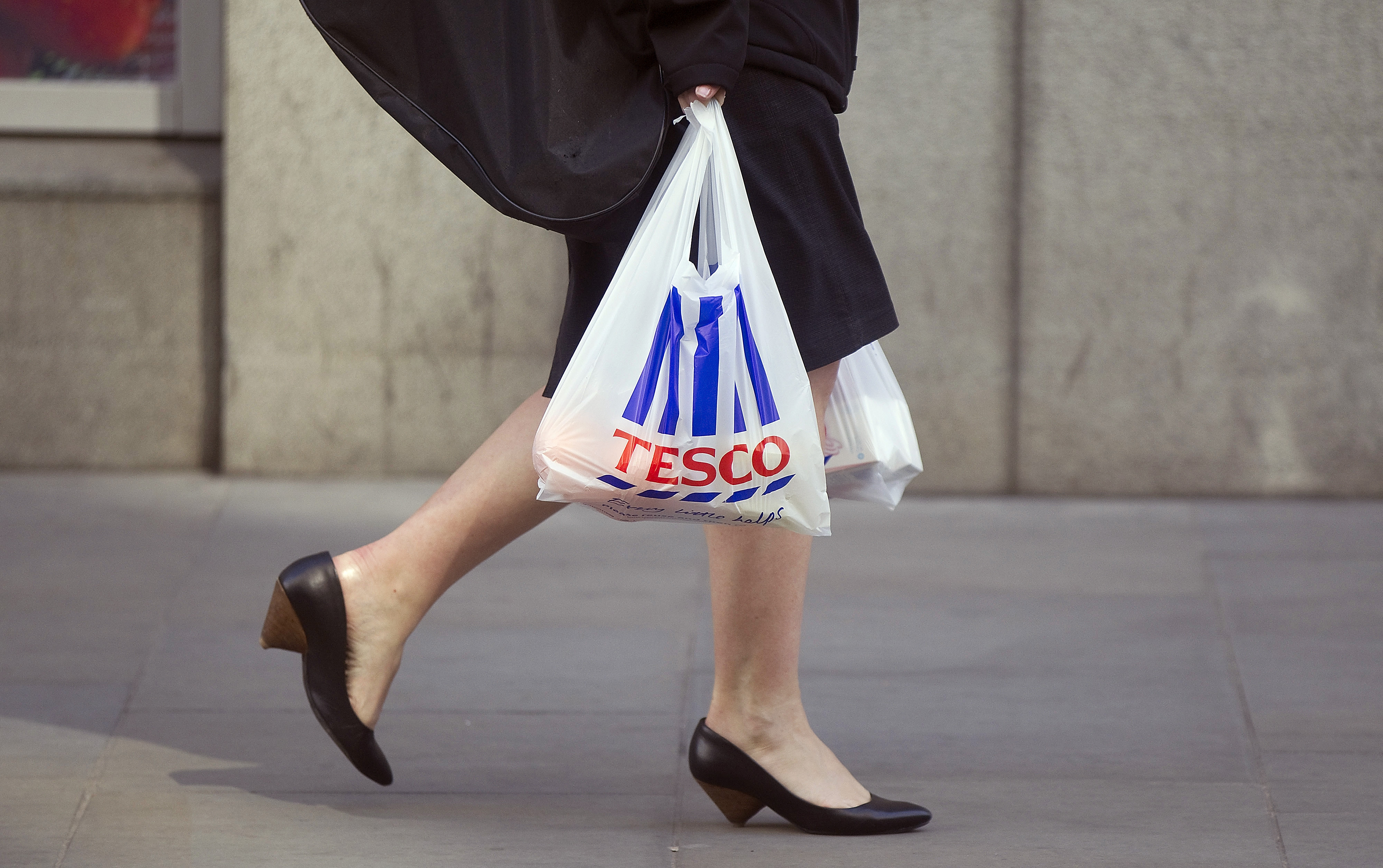 Tesco Plc Metro Stores As U.K. Business Flags