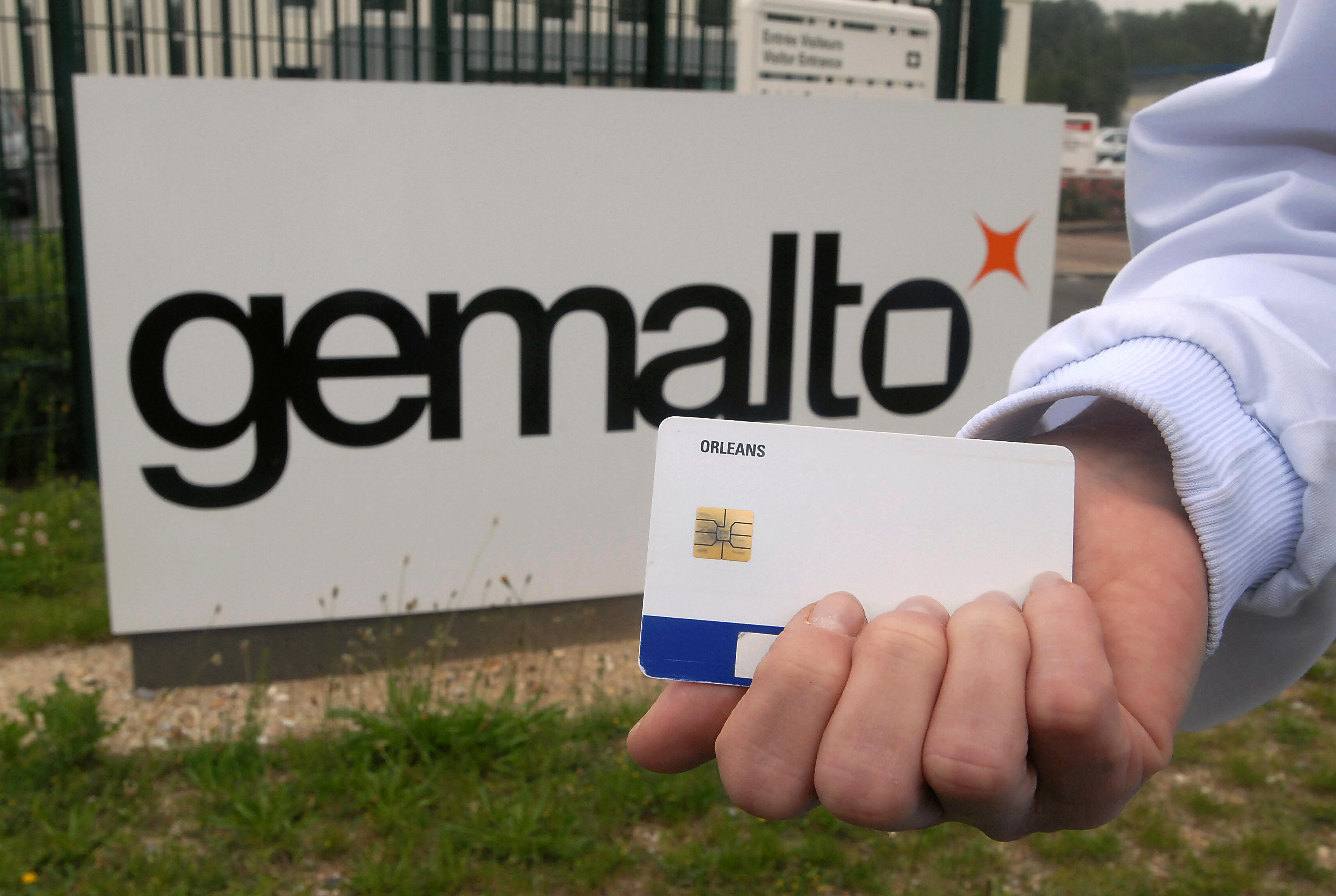 A man shows a process card in front of t