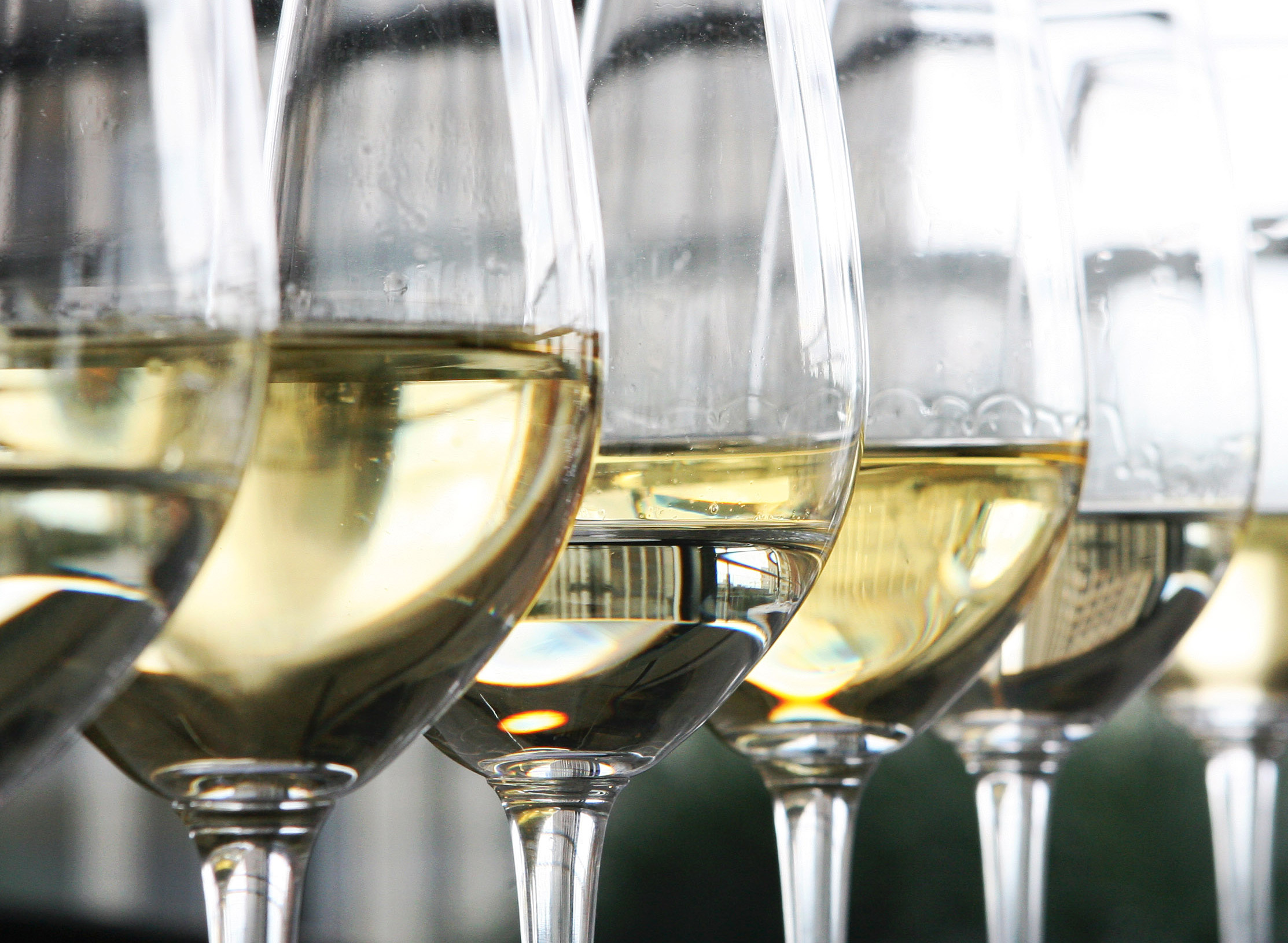 Glasses of white wine sit on display at a restaurant in Lond